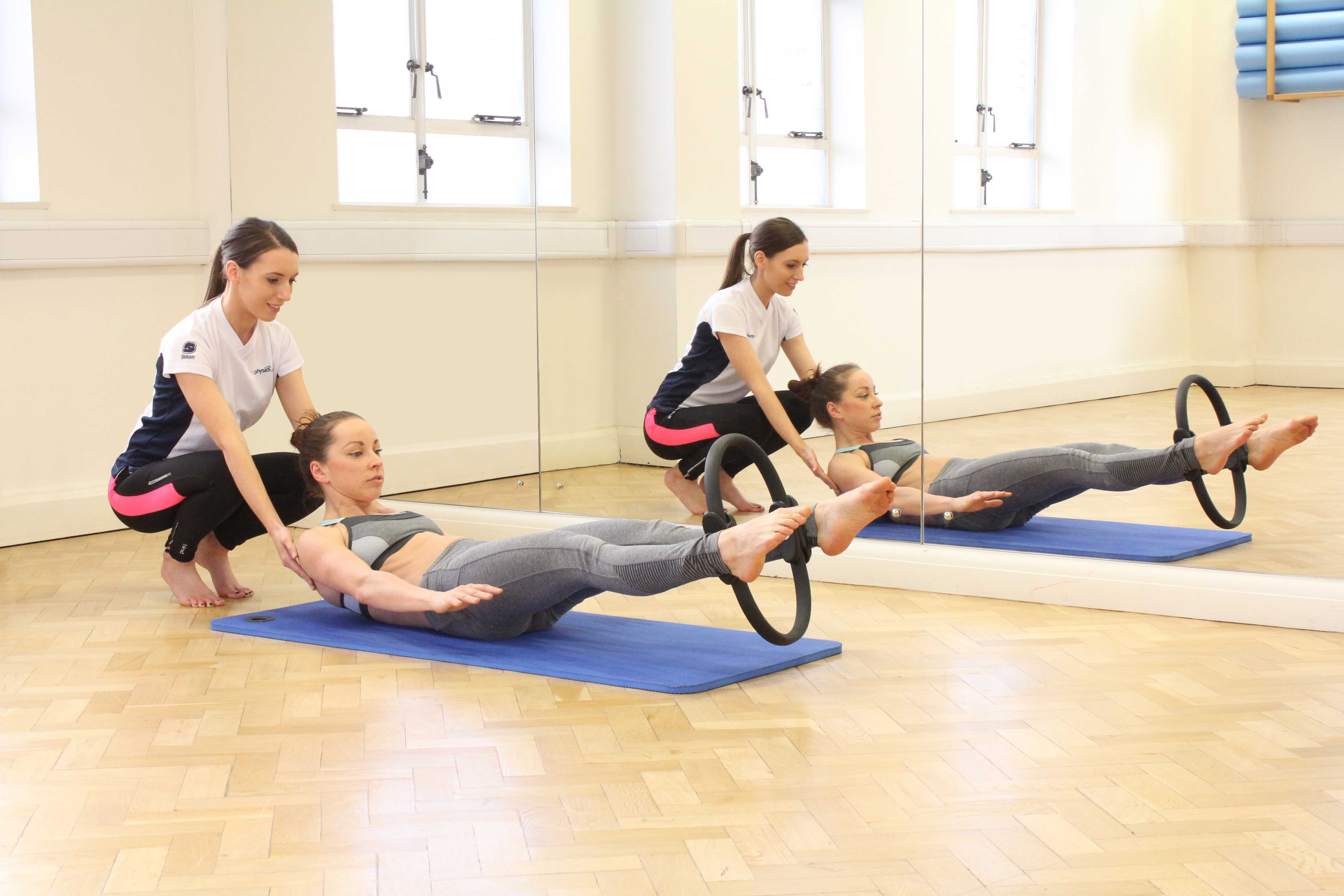 One to One Pilates session with specialist physiotherapist using ring