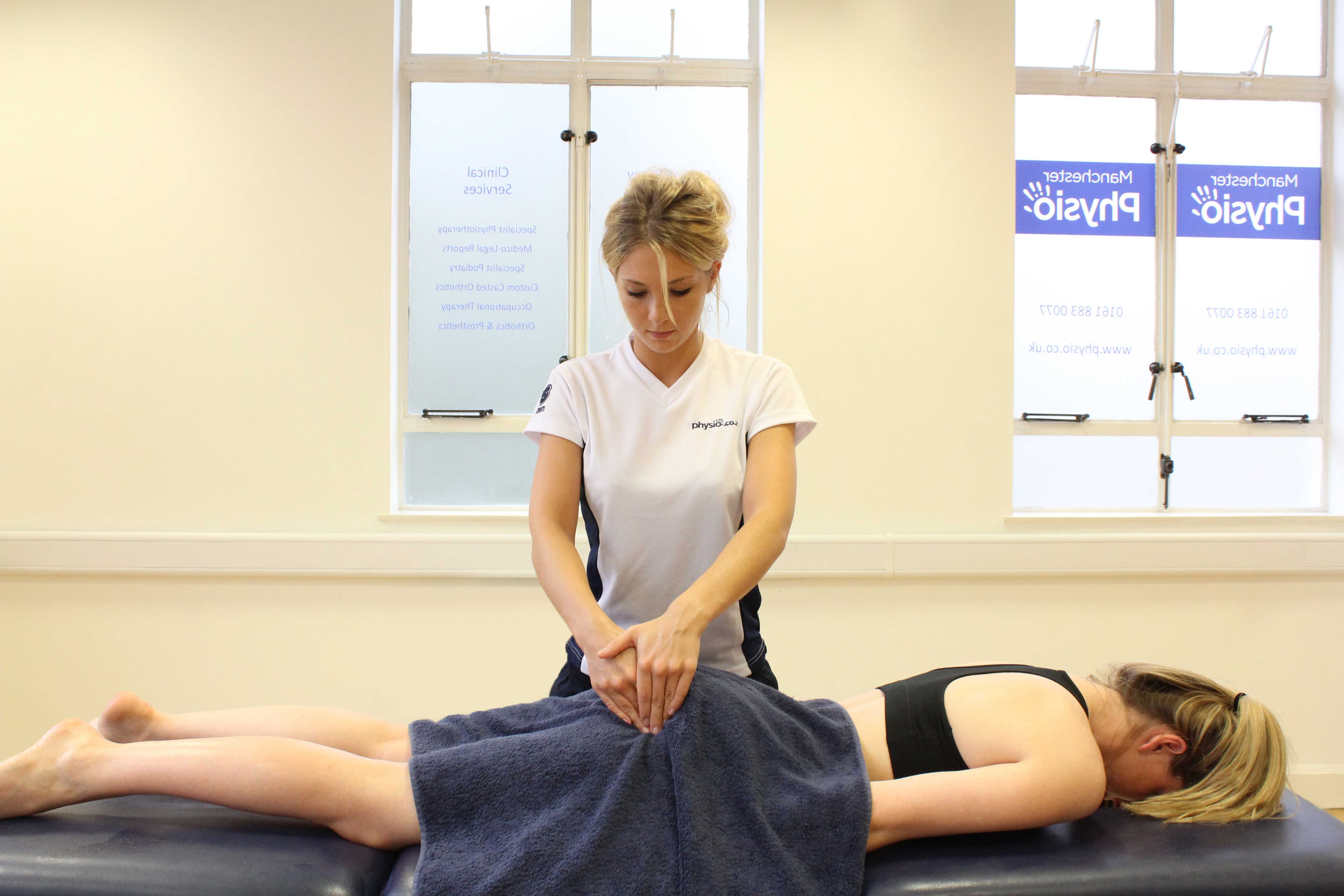 Therapist applying targeted massage to piriformis to relieve pain