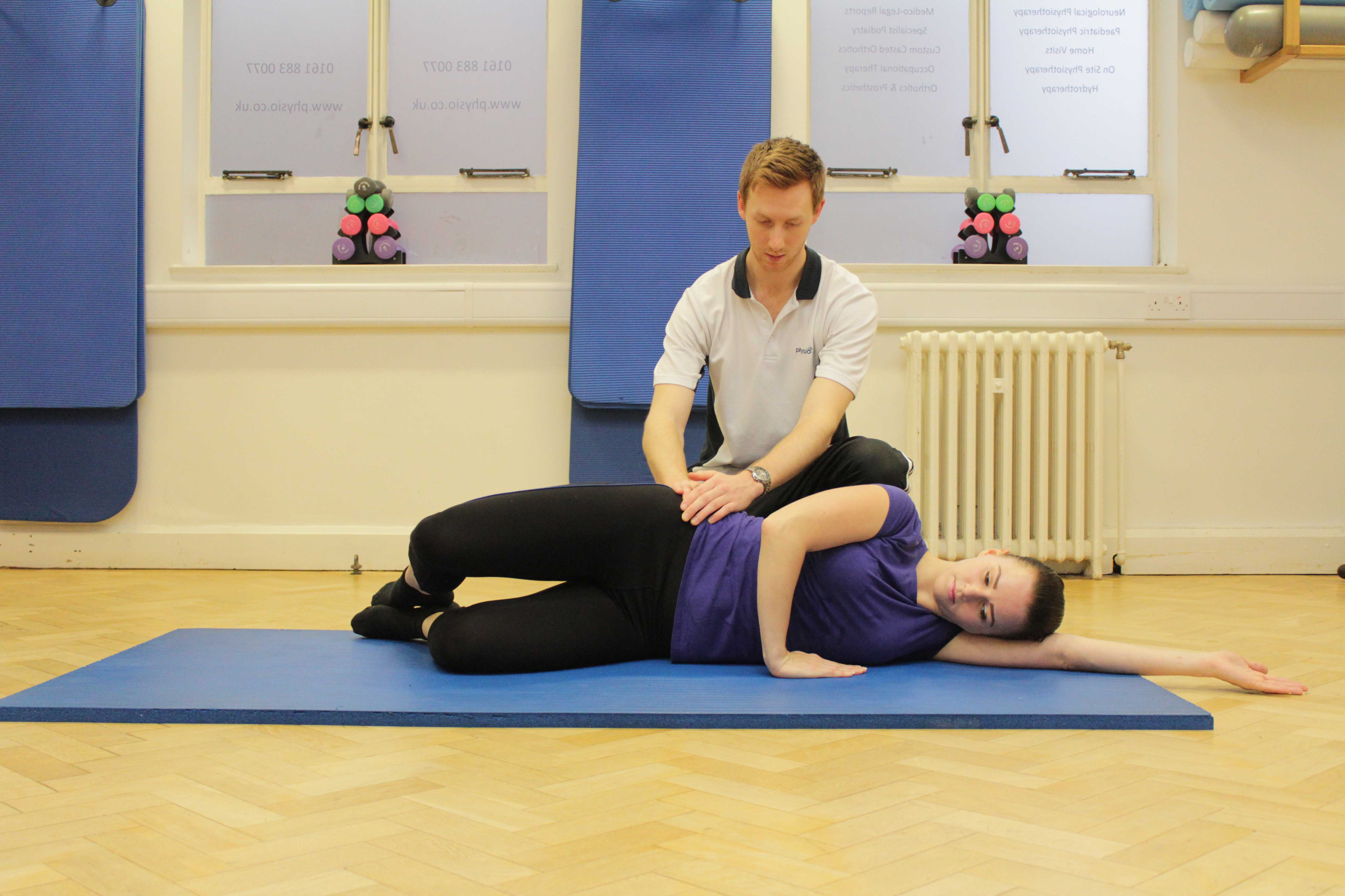 Strengthening exercises for the gluteus muscles supervised by a therapist