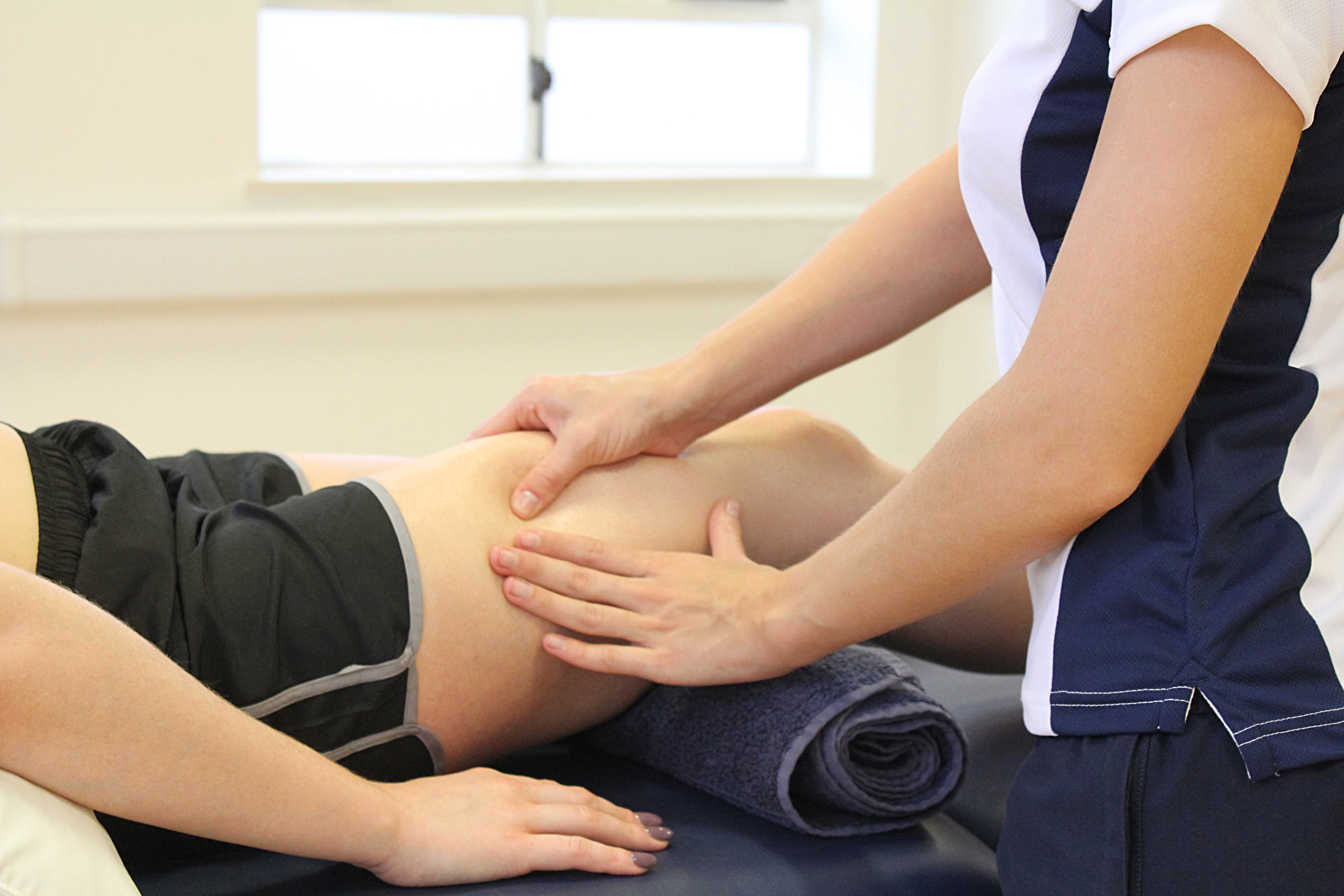 Rolling soft tissue massage of the quadriceps muscles