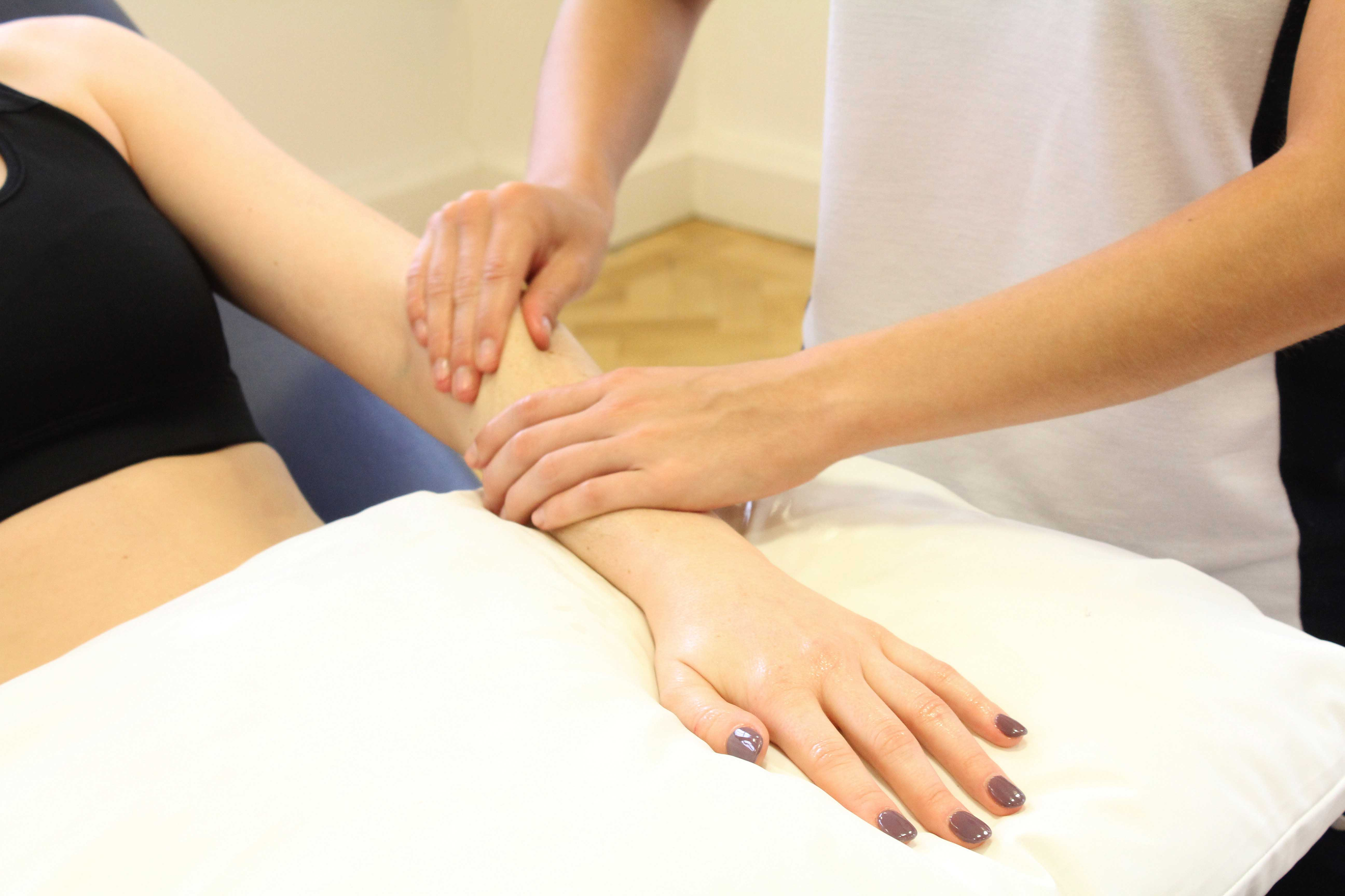 post injury massage of extensor capri ulnaris and digitorum to aid recovery.