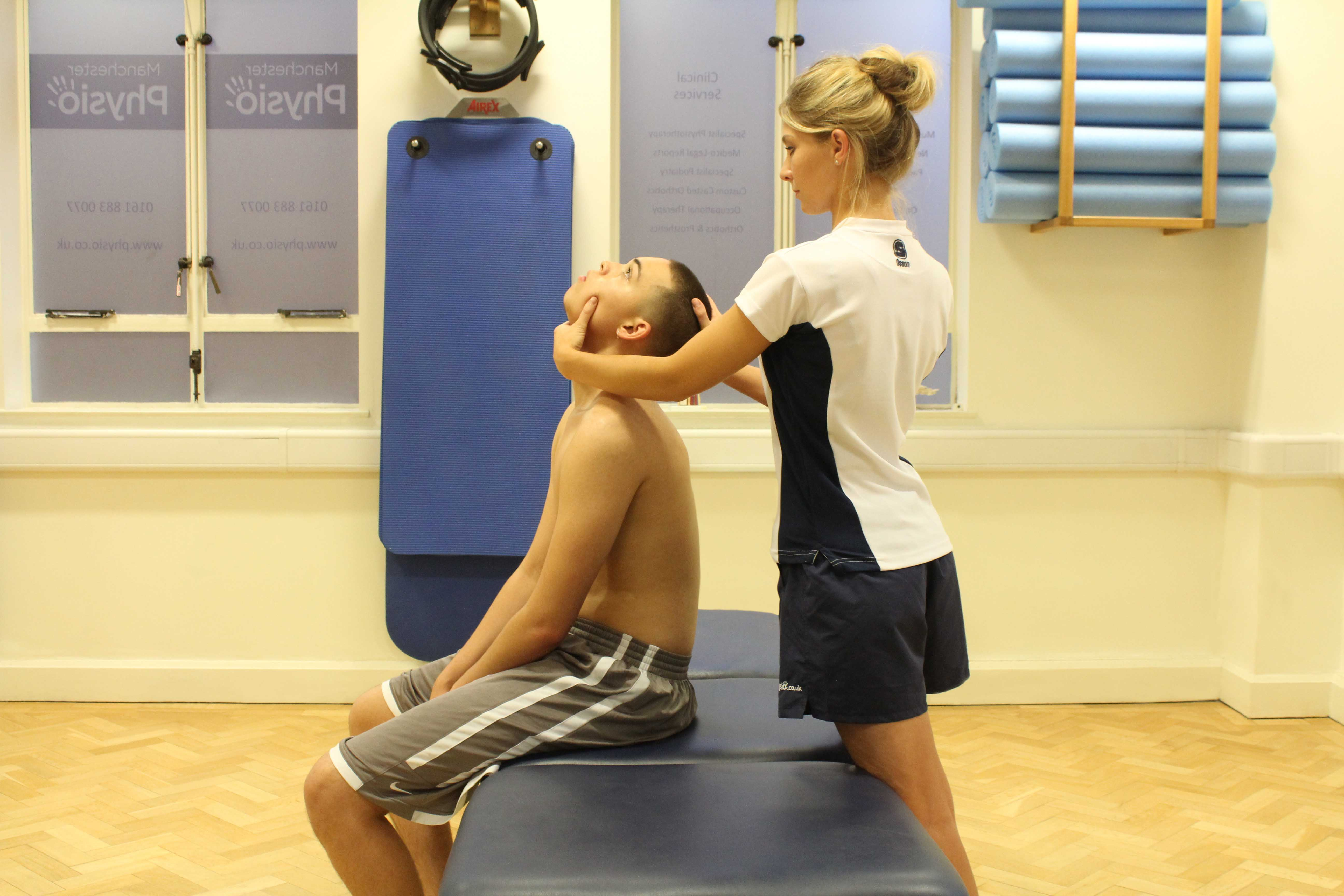 Stretches and realignment of the cervical spine by therapist