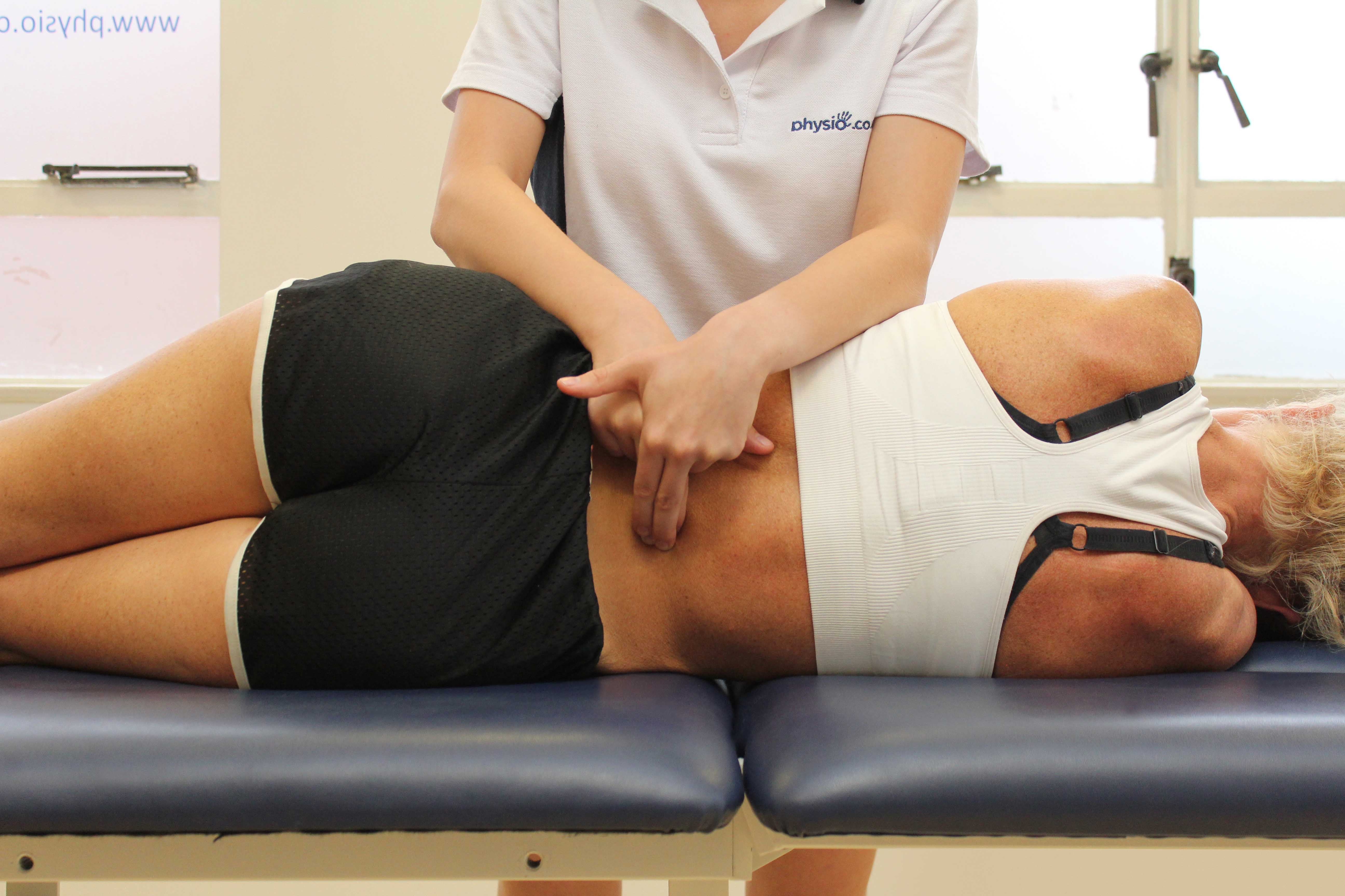 Mobilisations of the lumbar vertebrea by a physiotherapist