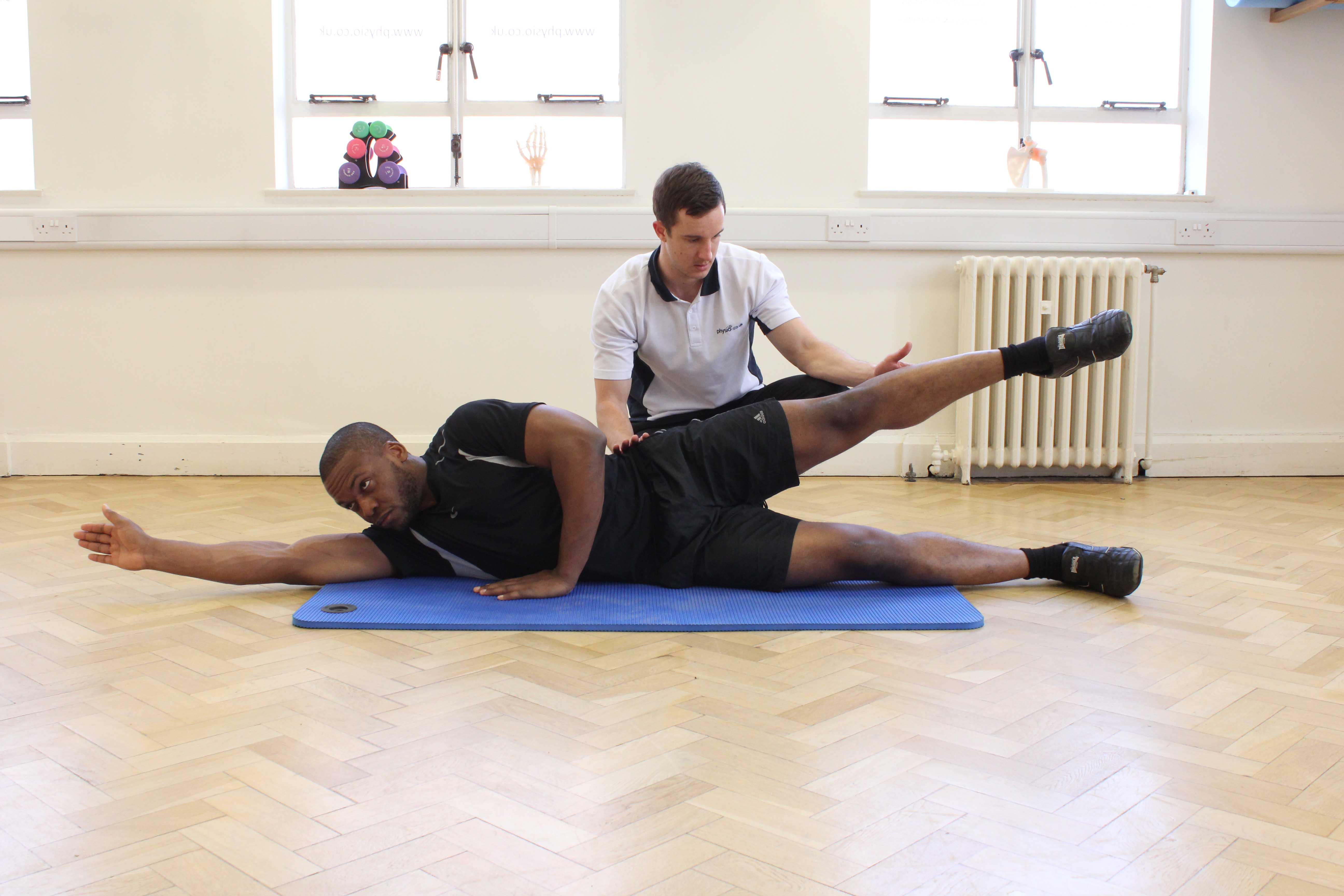 Progressive hip abductor strengthening exercises supervised by specialist MSK therapist