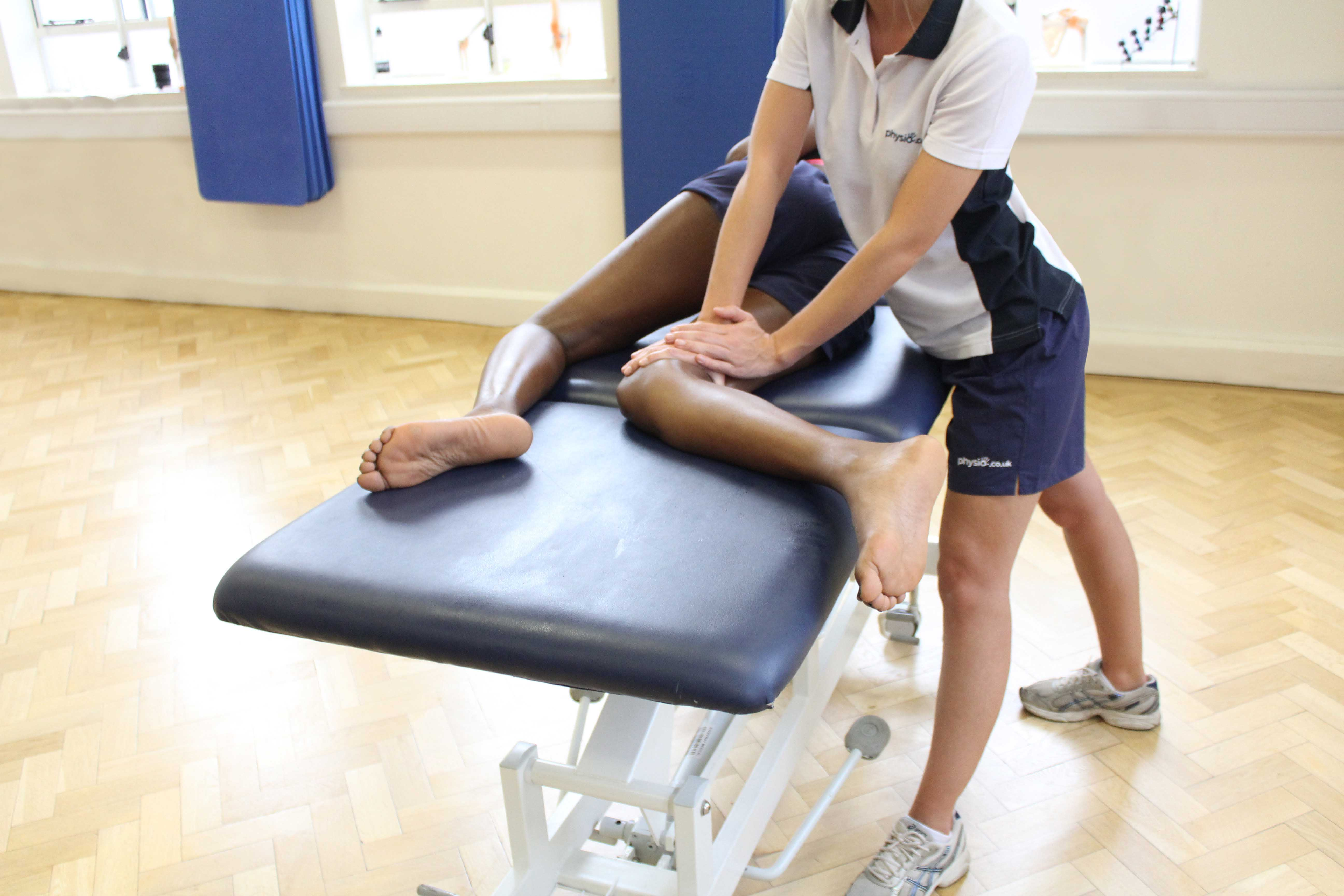 Soft tissue massage of the hamstring muscles by experienced therapist