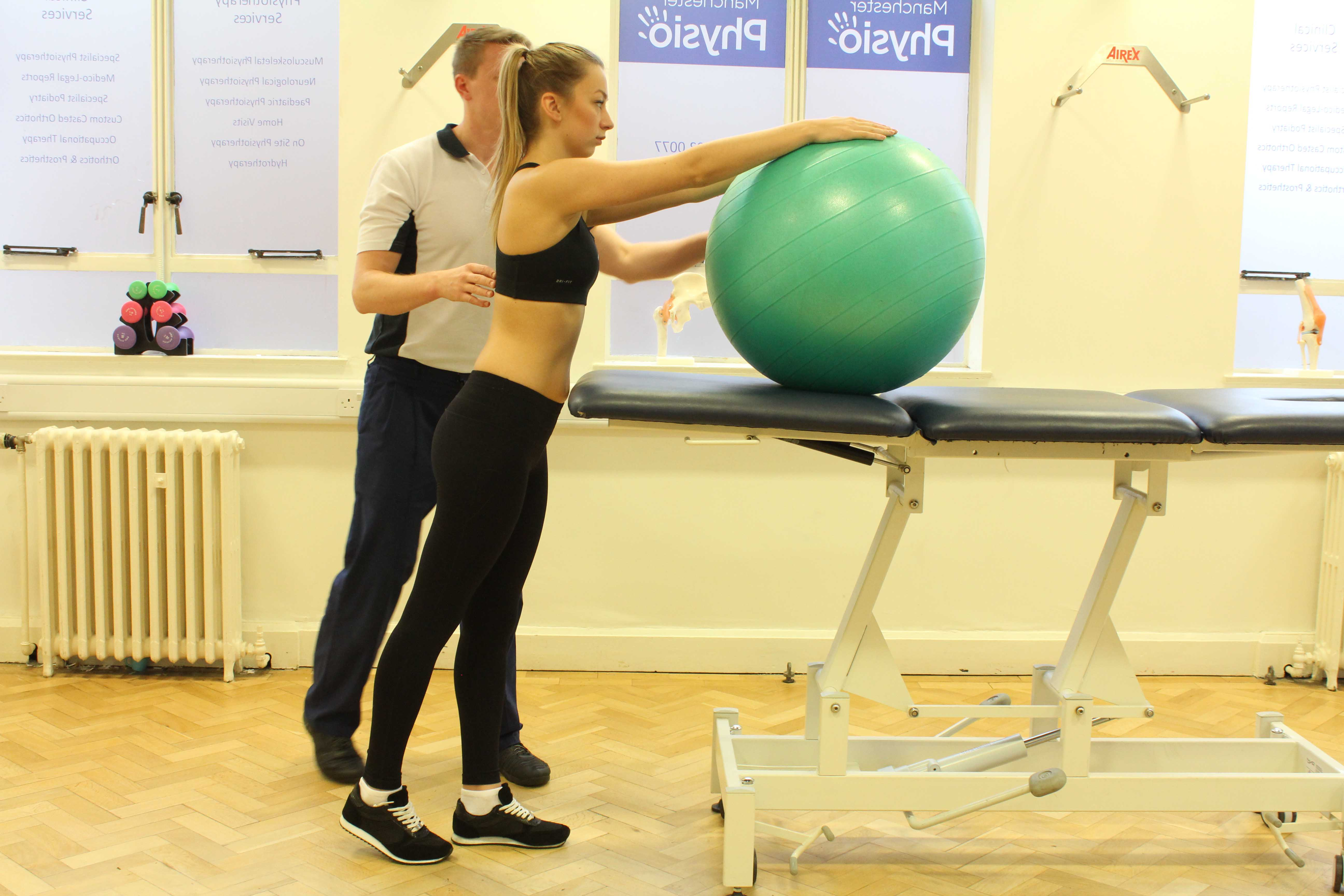 Gym ball assisted shoulder stretches under supervision of physiotherapist