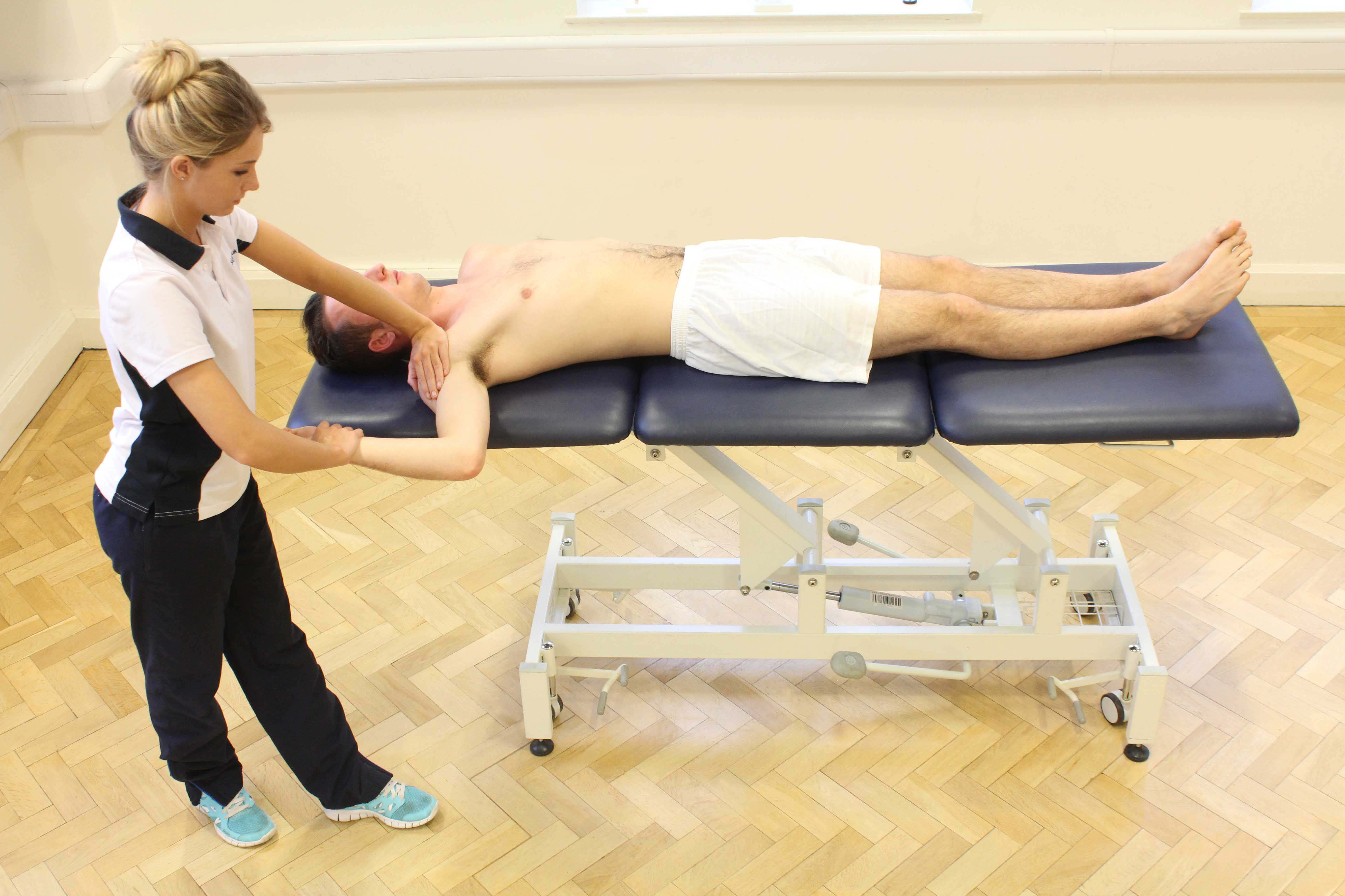 Soft tissue massage of the palma fascia to relieve pain and stiffness