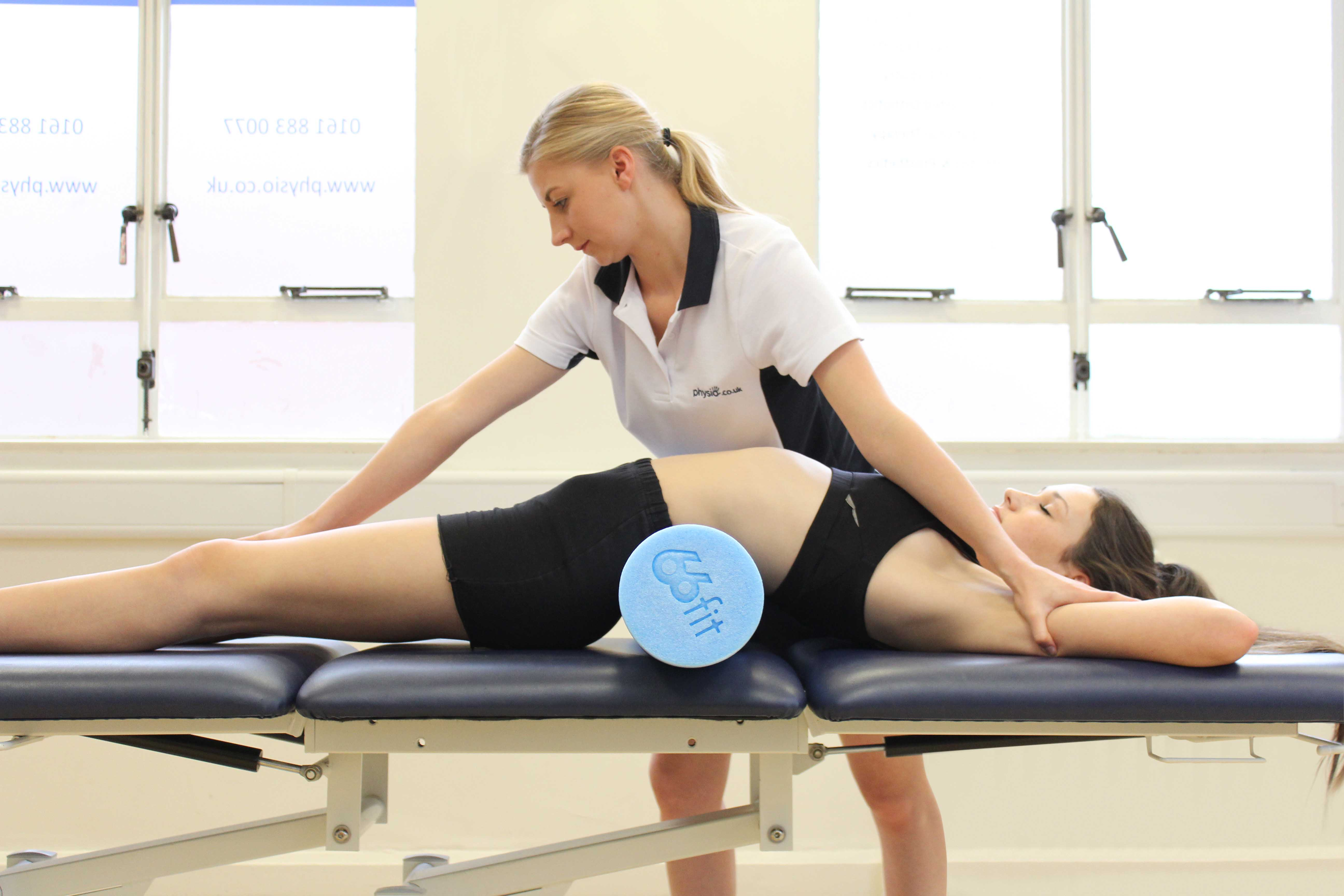 Soft tissue massage of the abdominal muscles by an experienced therapist