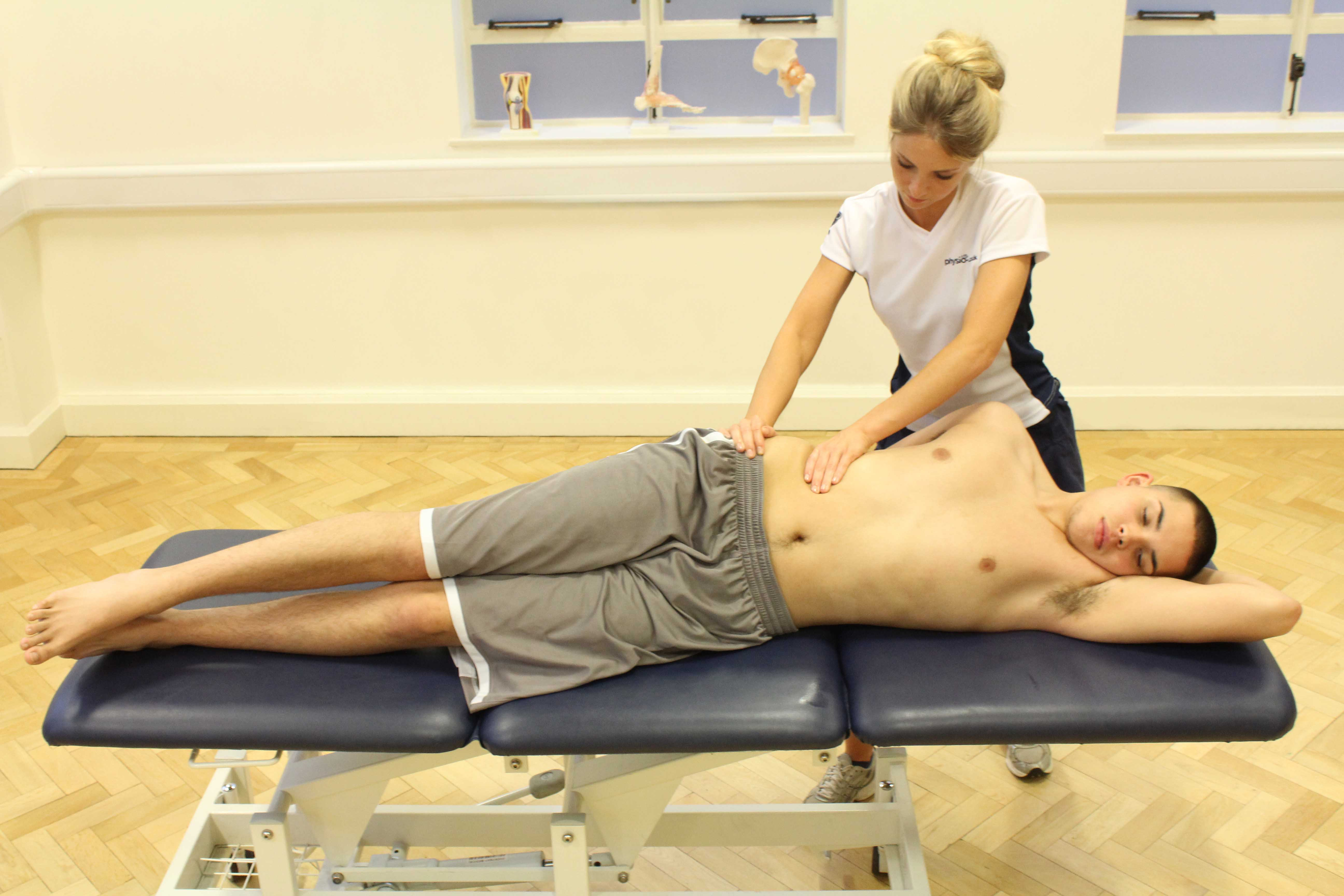 Soft tissue massage of abdominal oblique muscle