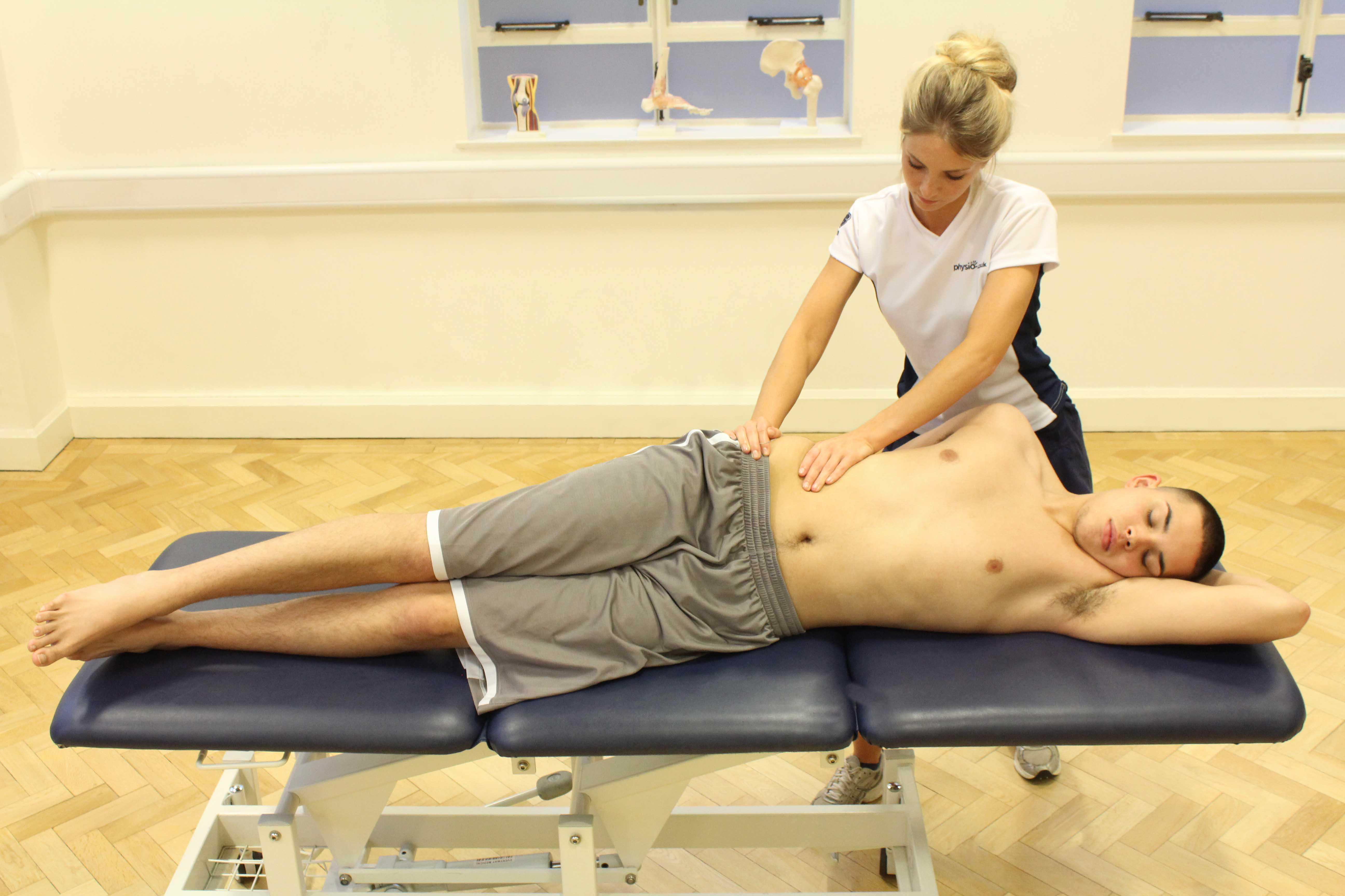 Stability and strengthening exercises conducted on a wobble board with the assistance of a specialist physiotherapist