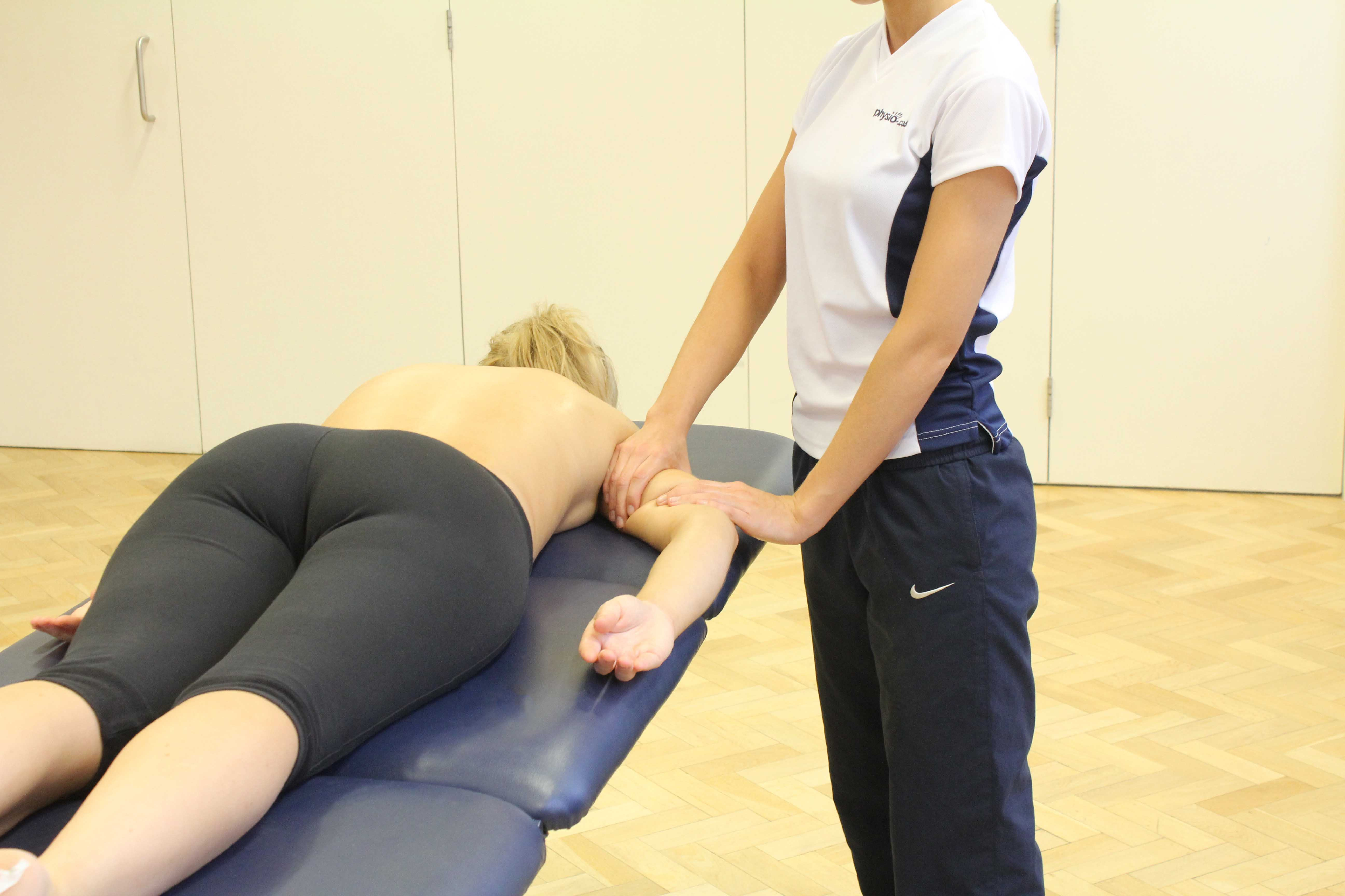 Experienced neurological physiotherapist performing PNF exercises on a client