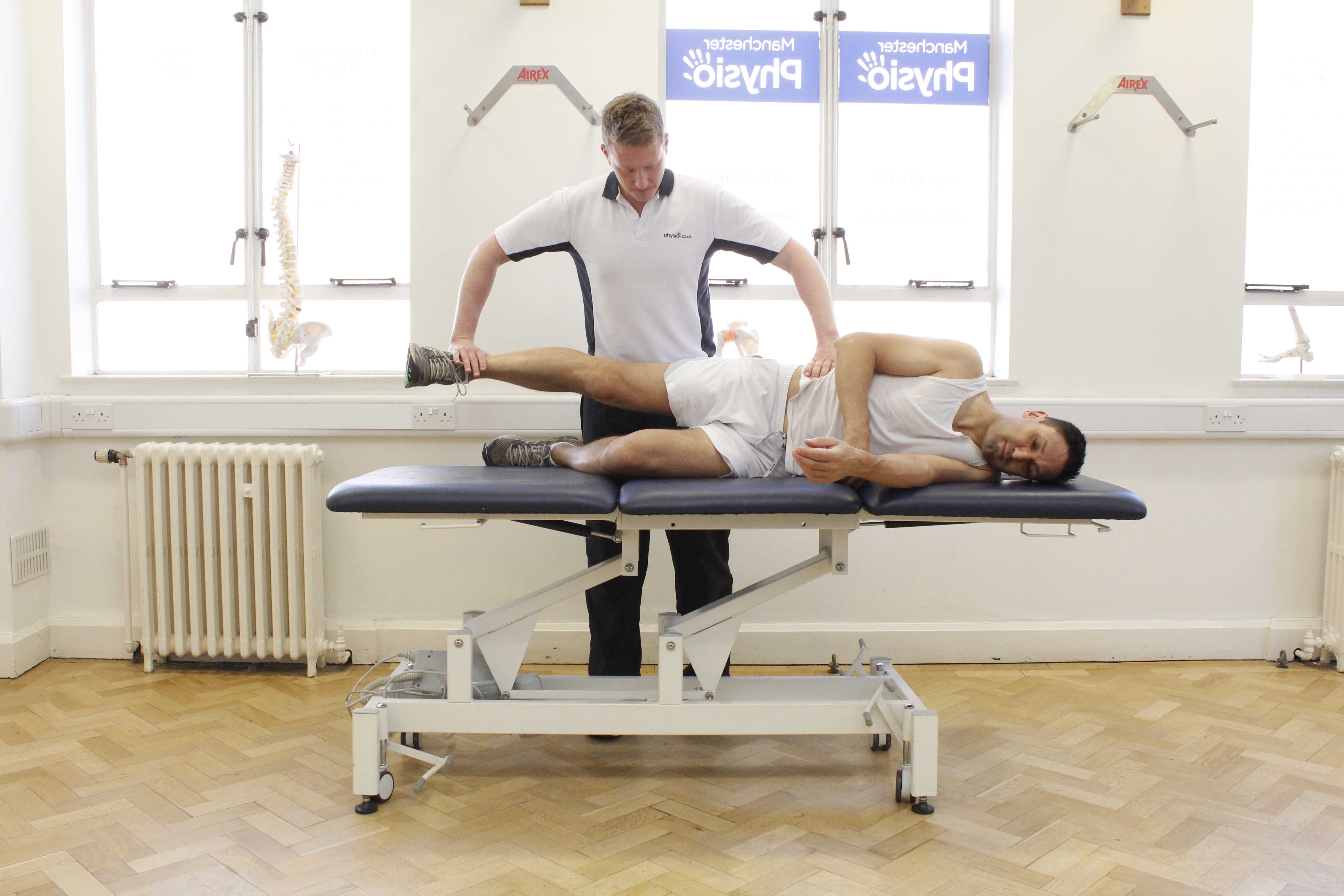 Hip abductor strengthening exercises assisted by a MSK physiotherapist