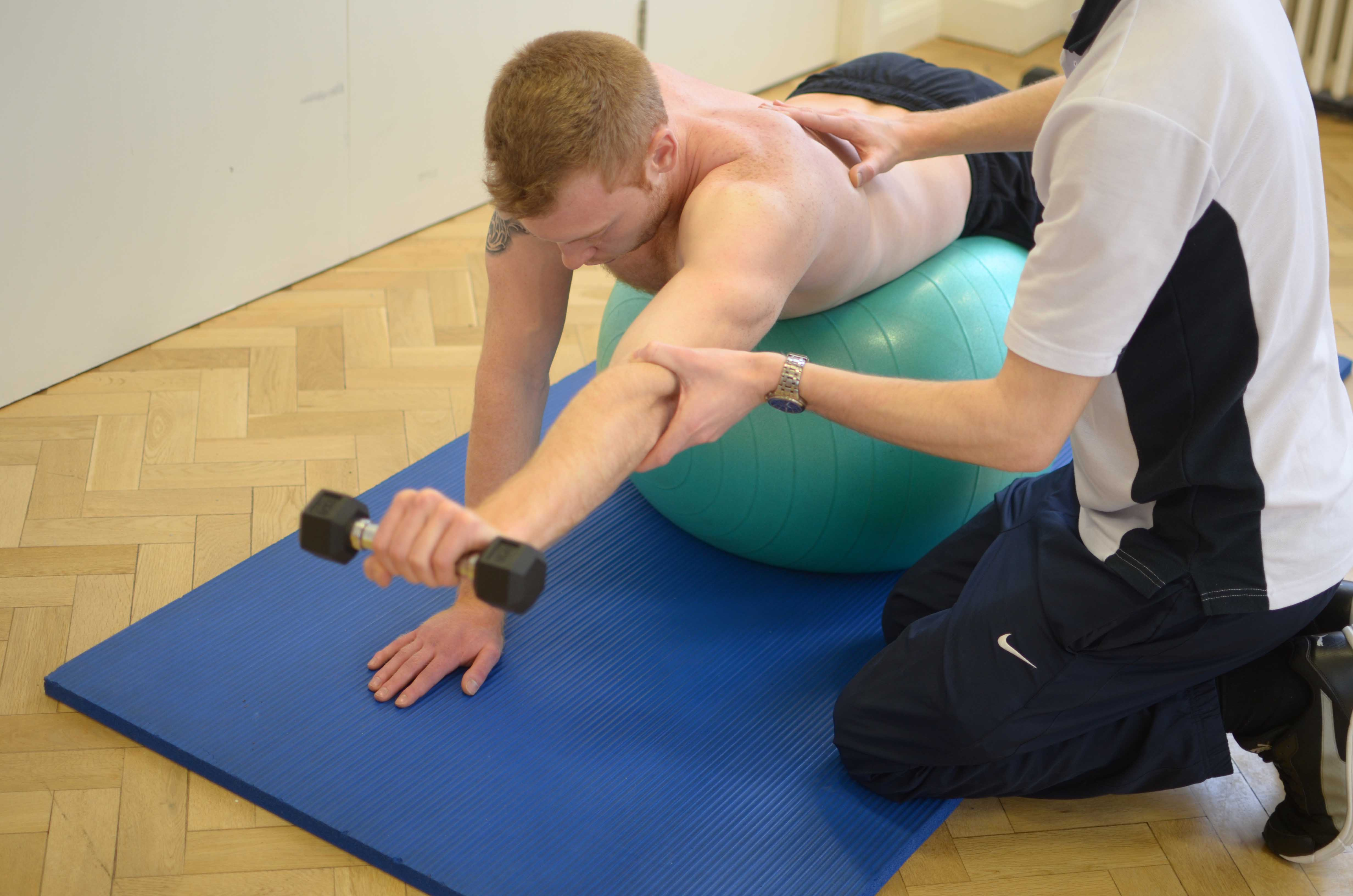 Progressive strengthening exercises isolating the upper back muscles