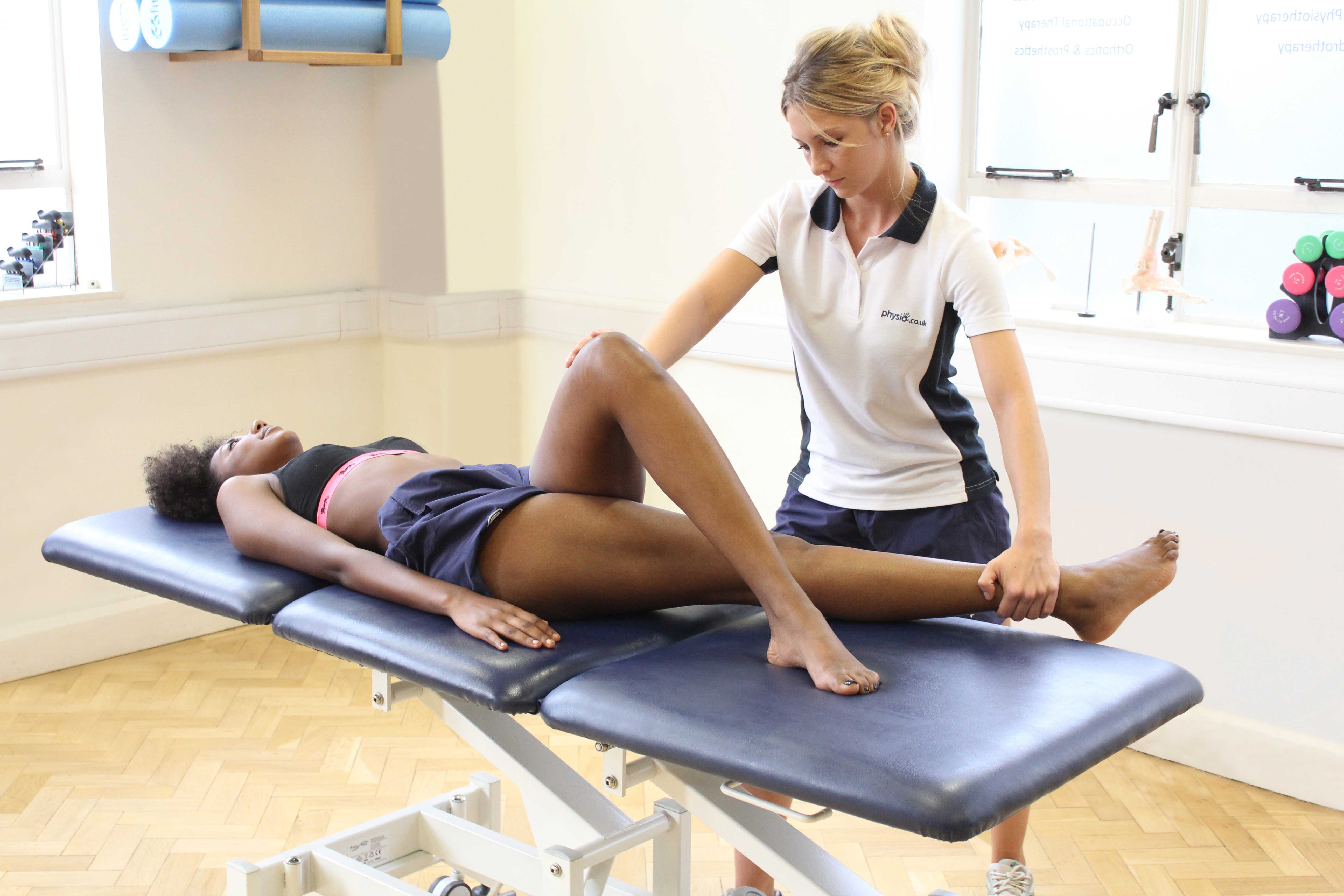 Leg strengthening exercises on a cross trainer supervised by an experienced physiotherapist