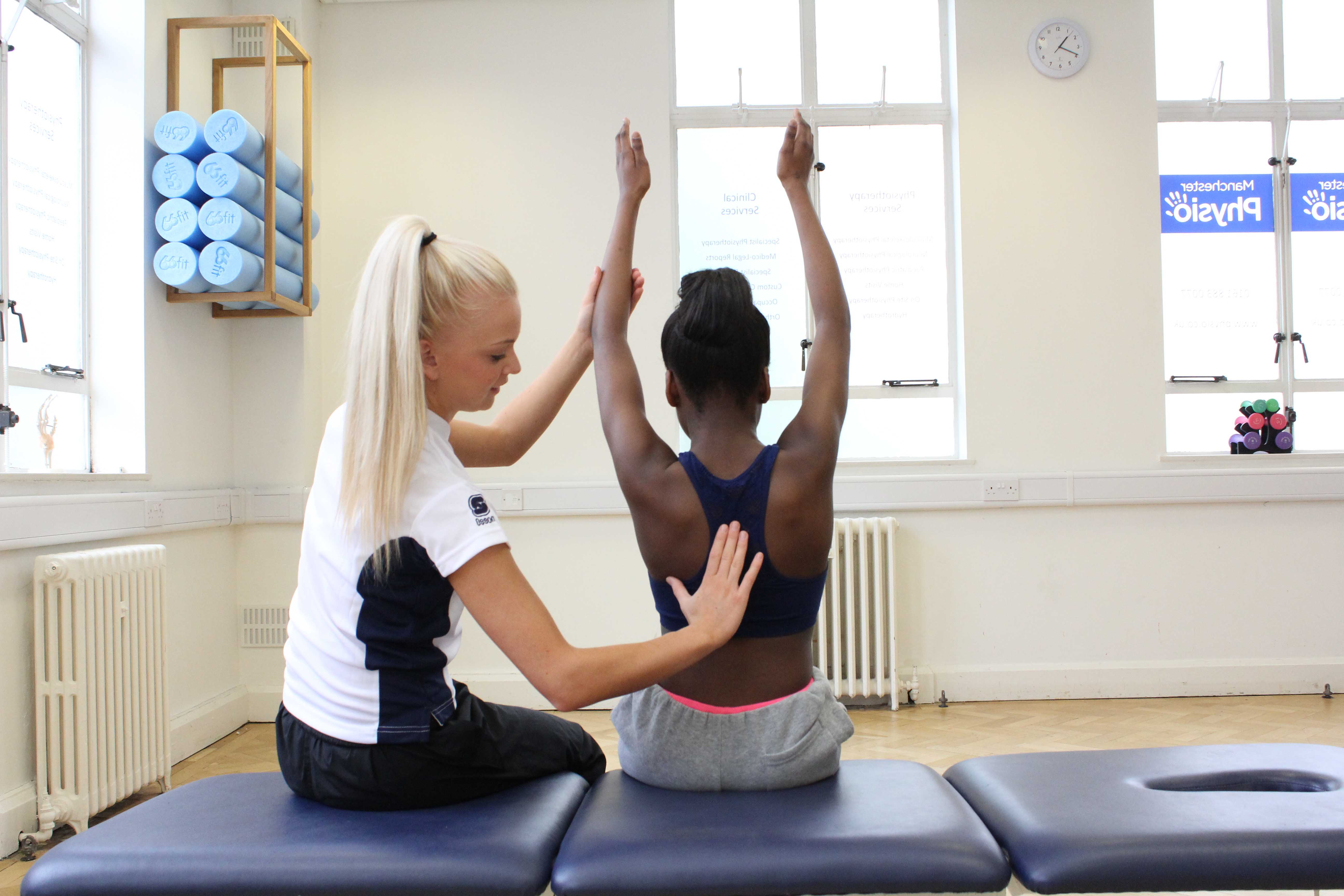 Trigger point massage of the lower back muscles by specialist MSK therapist