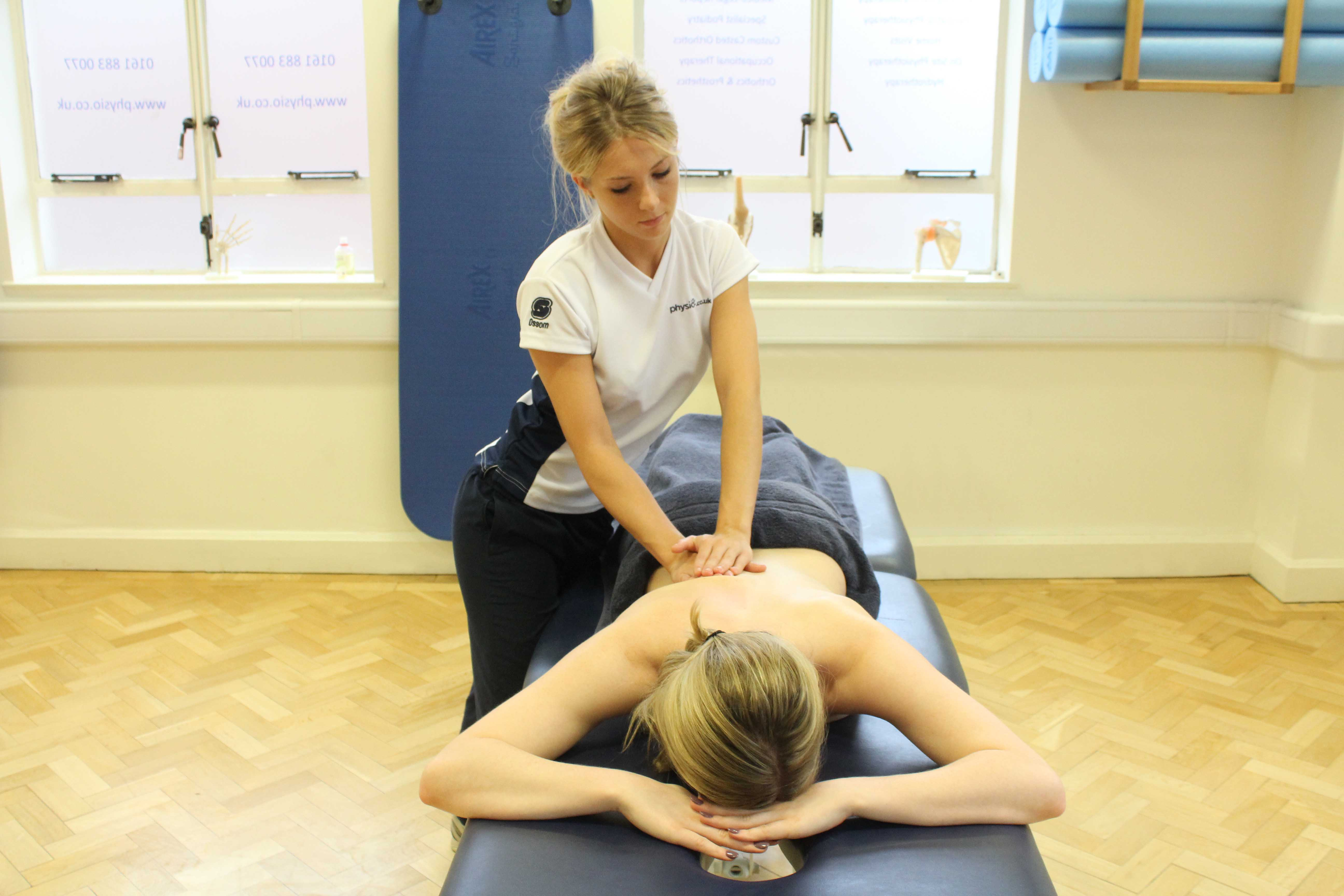 Beating percussion soft tissue massage applied by an experienced therapist