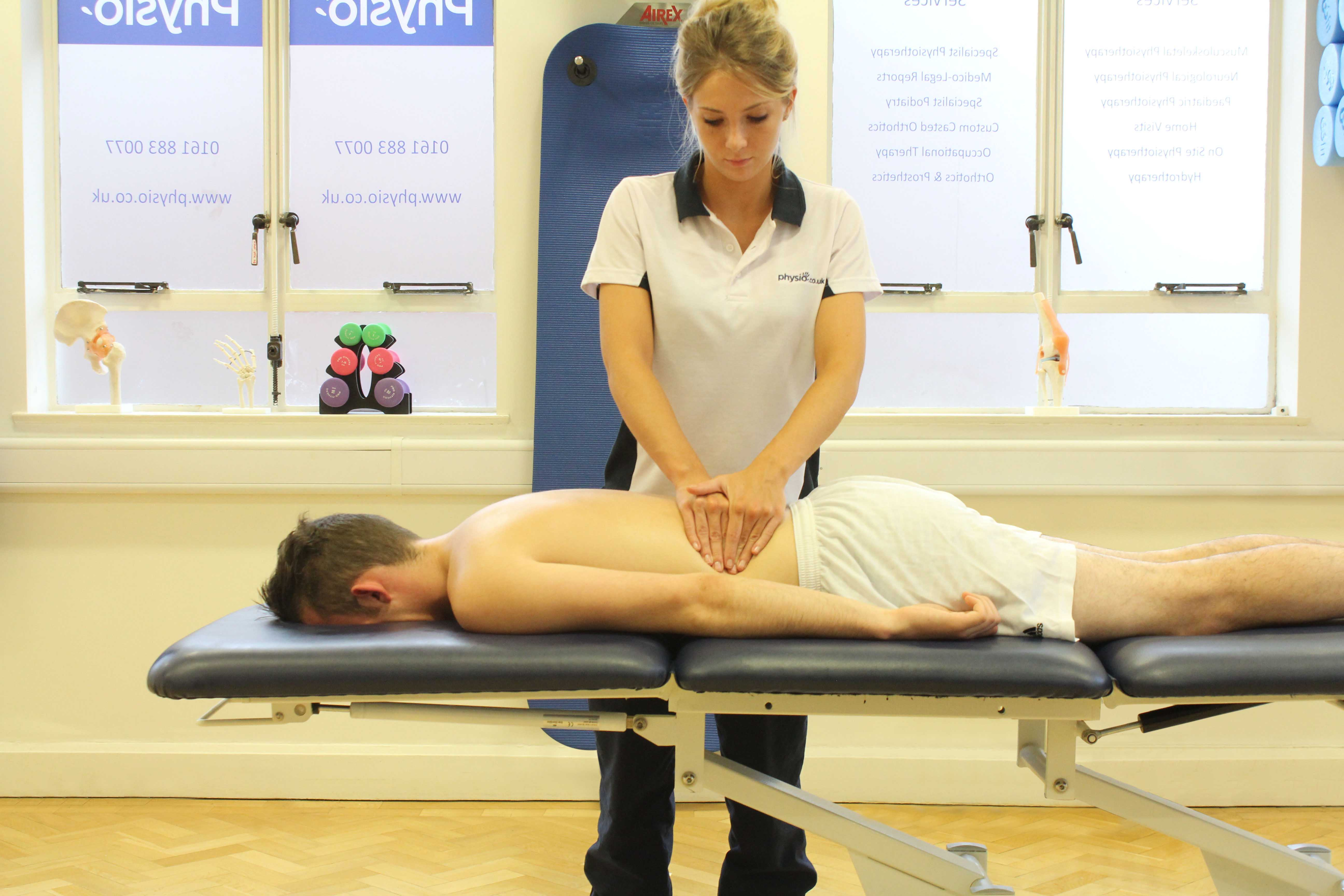 Soft tissue massage of the muscles in the lower back