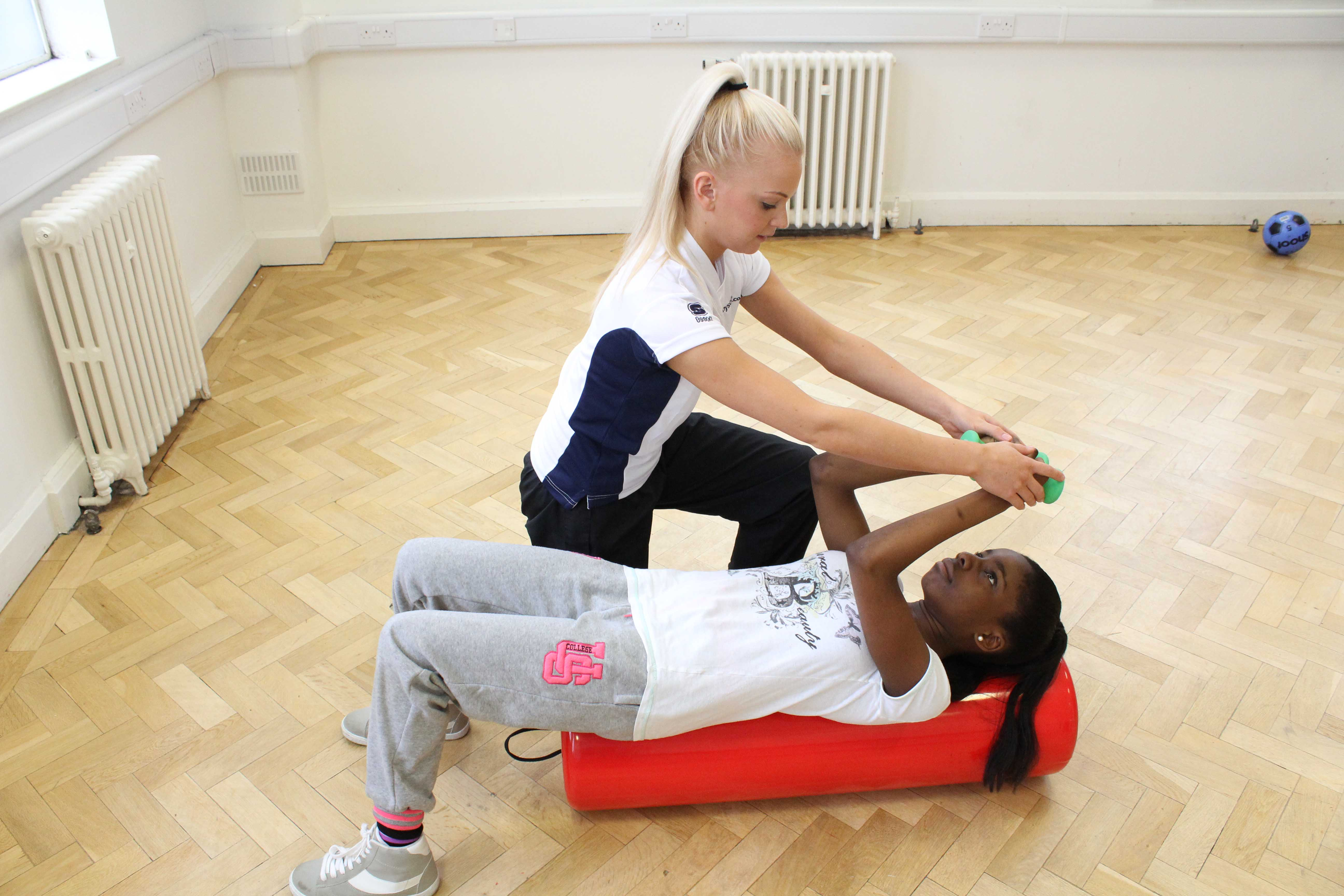Gross motor skills, proprioception and muscle tone exercises assisted by a paediatric physiotherapist