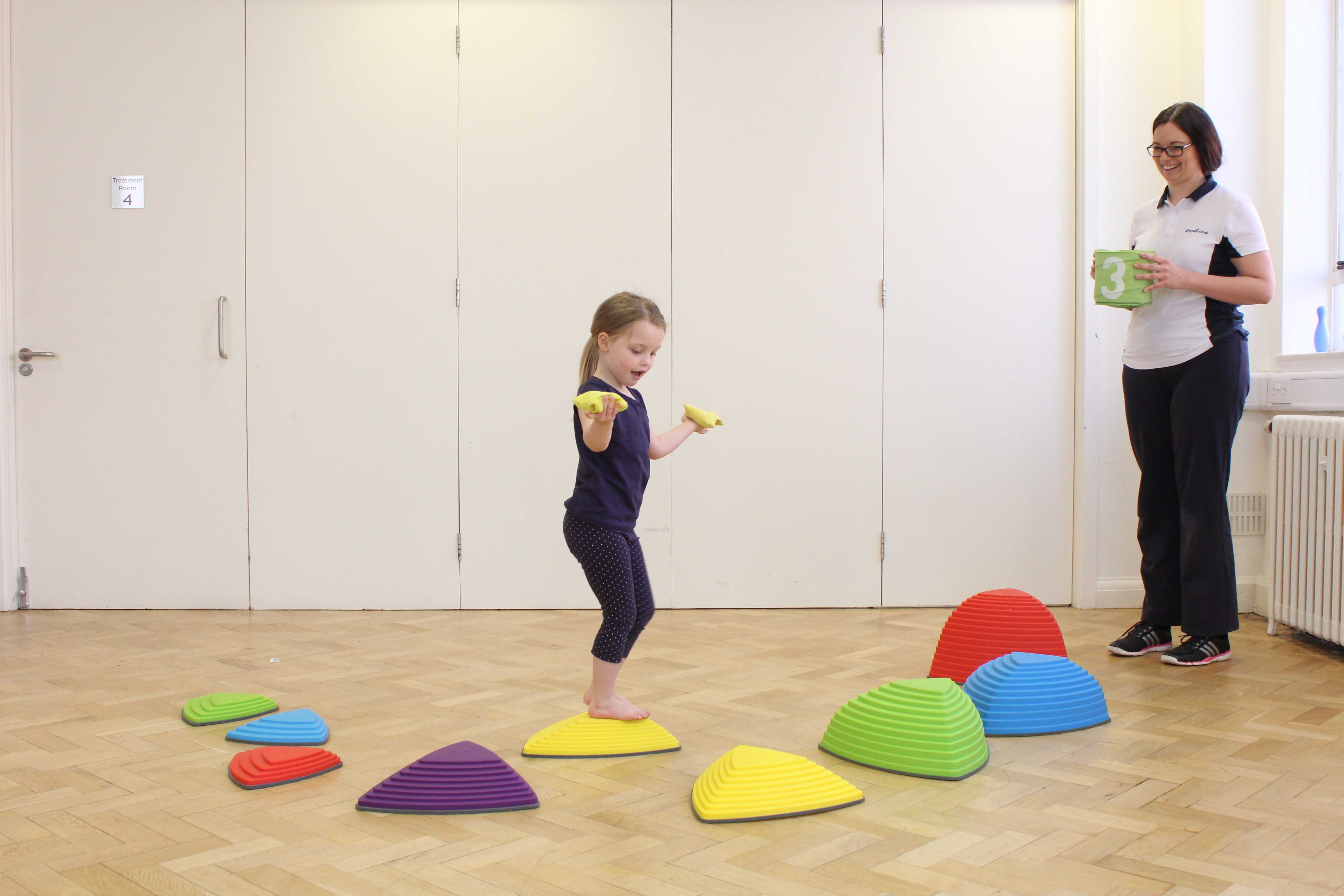 Overcomig sensory defensiveness through play activities supervised by a paediatric physiotherapist