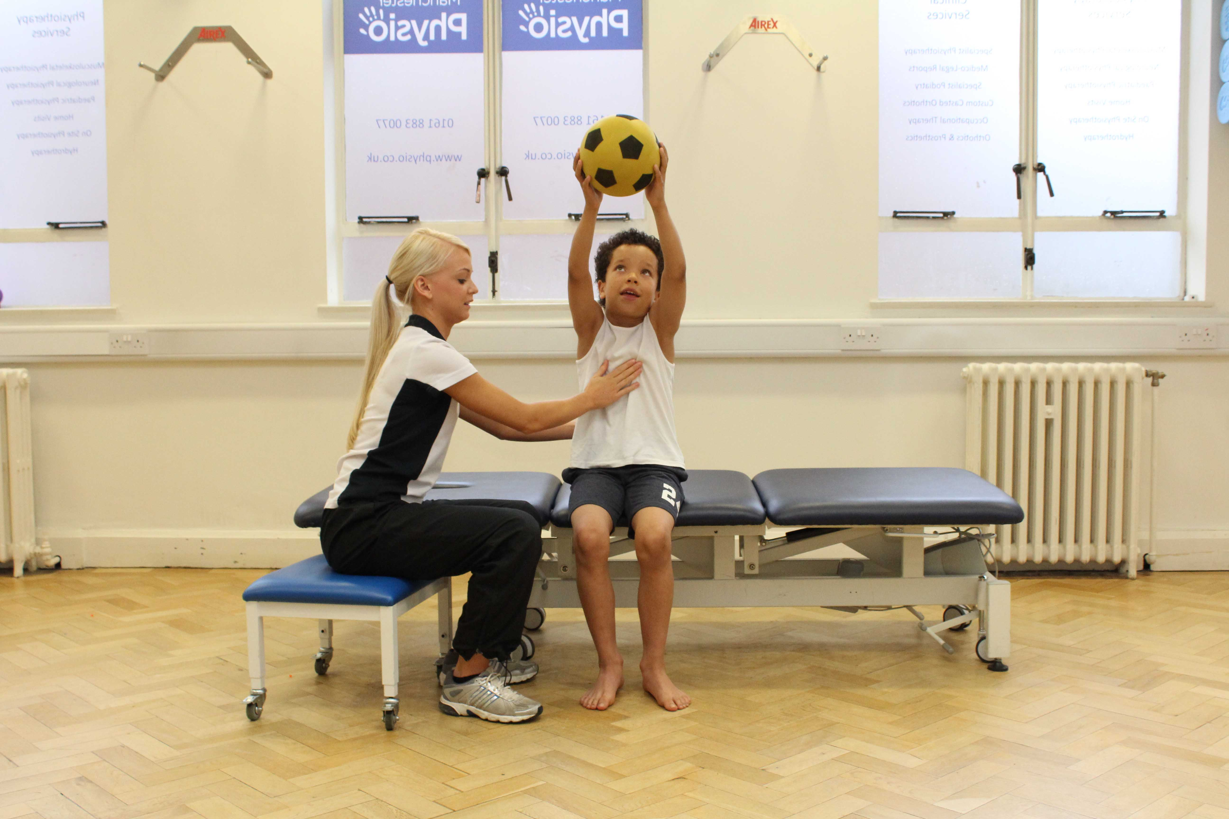Mobilisation and proprioception exercises supervised by a paediatric physiotherapist