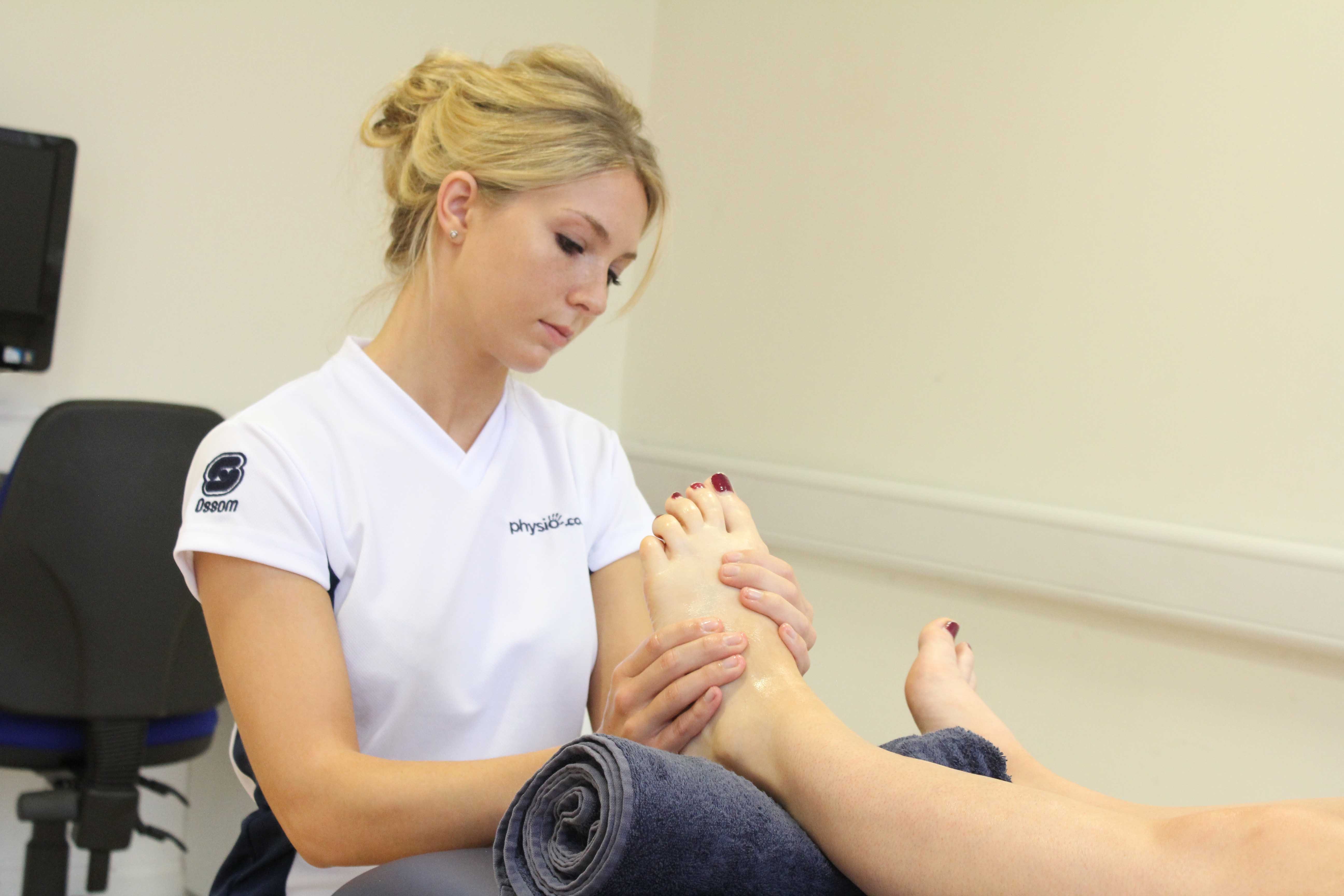 Soft tissue massage of the planta fascia along the sole of the foot.