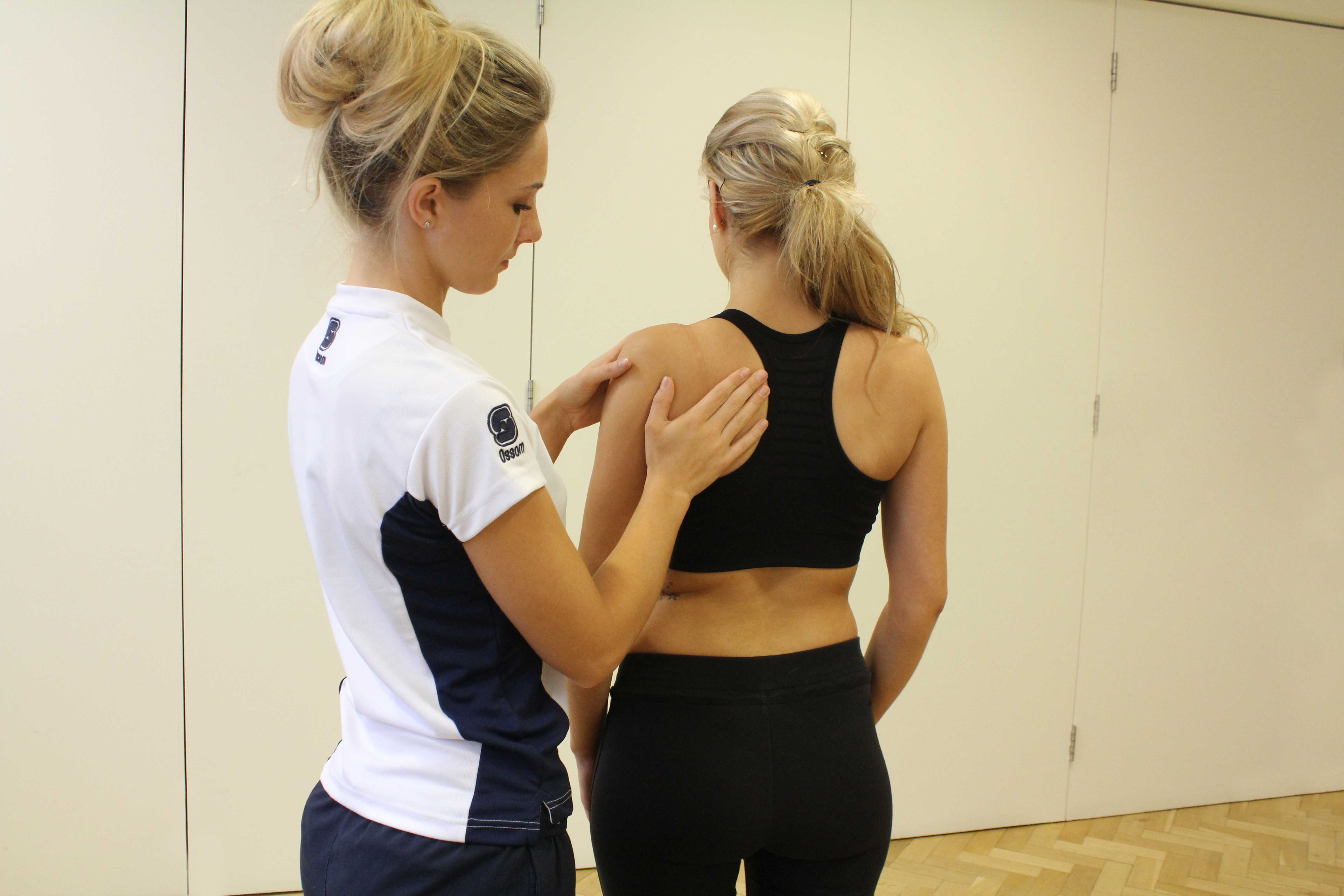 Shoulder assessment conducted by experienced therapist