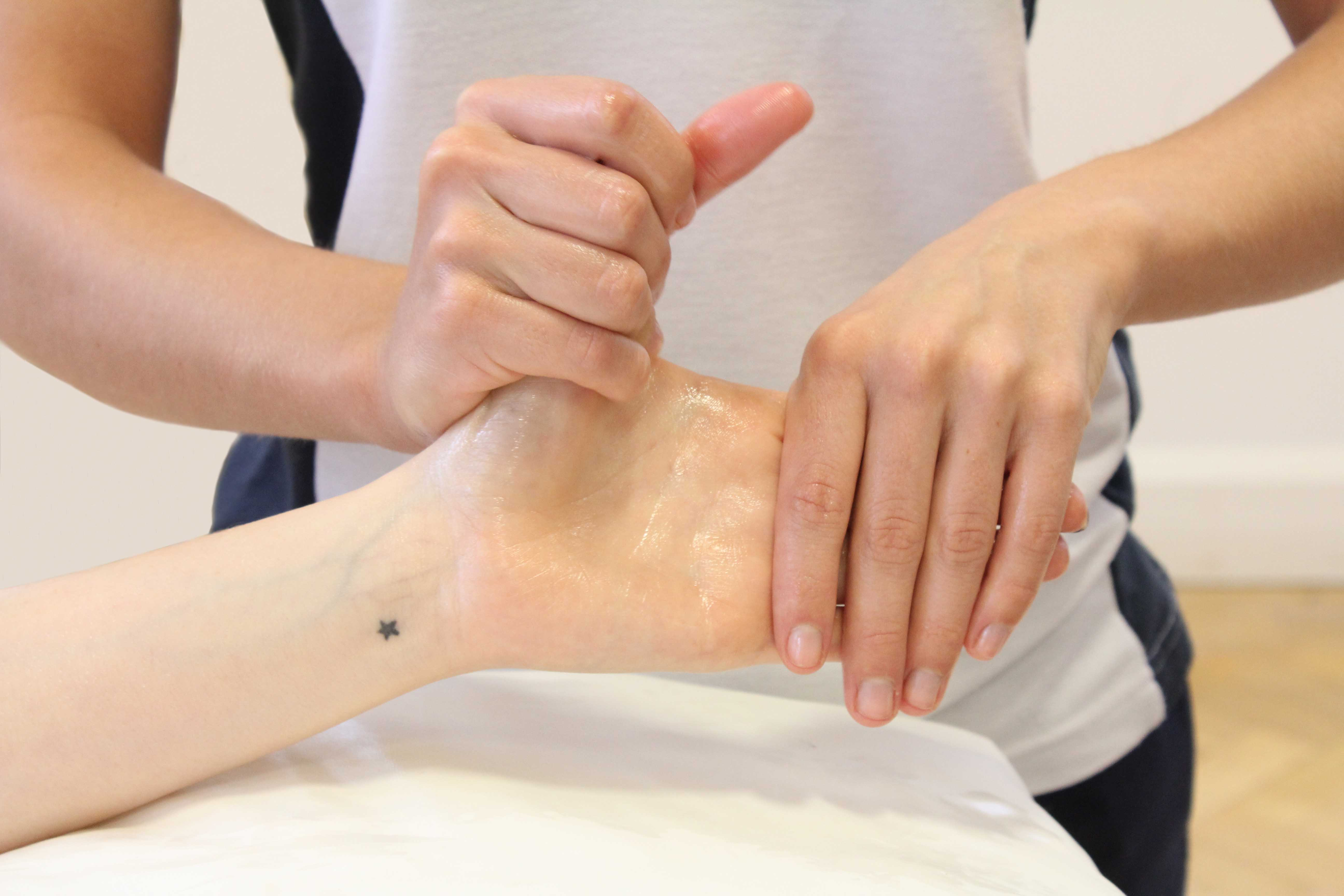 Soft tissue massage and stretches applied to the thumb and fingers