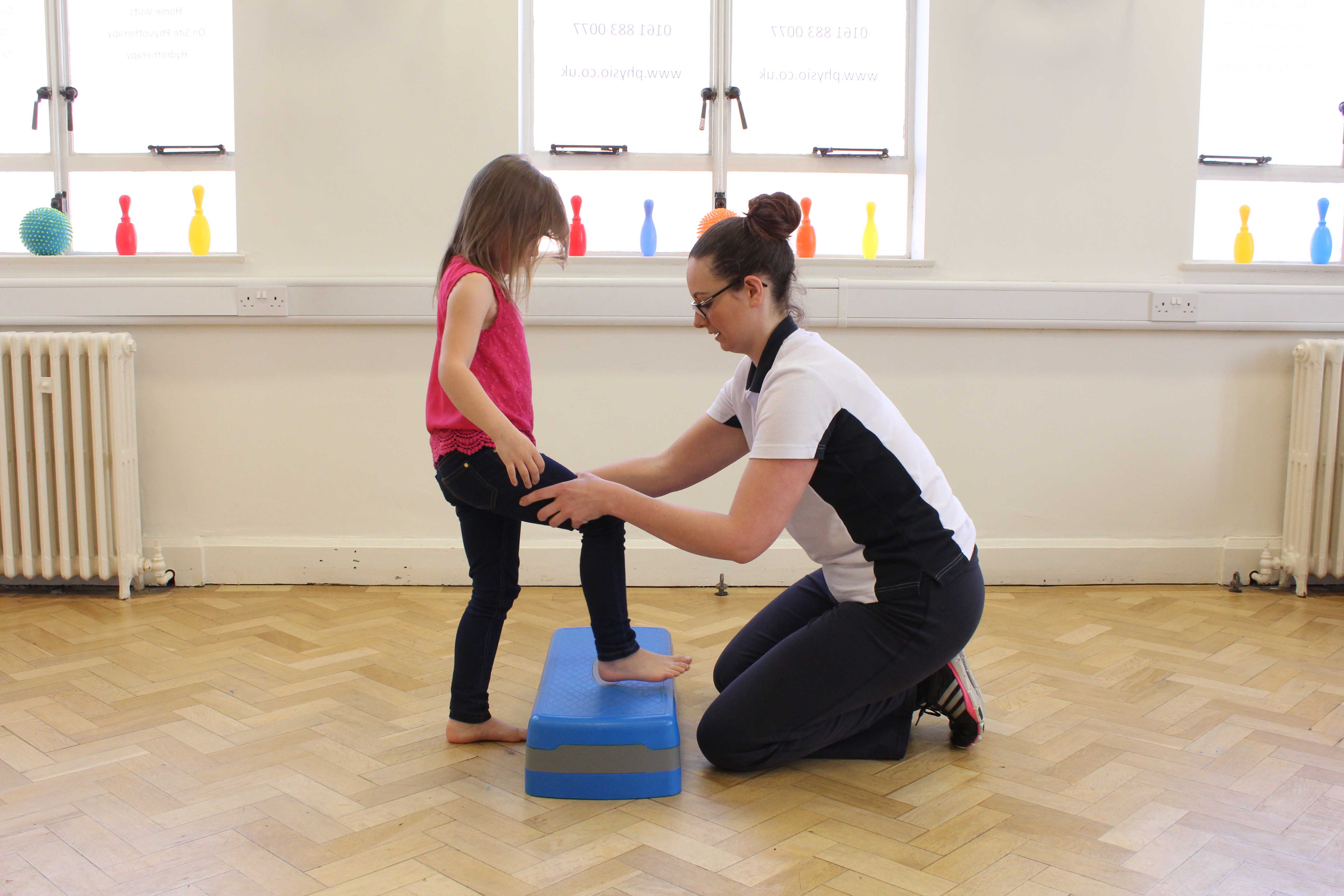 Functional mobility exercises assisted by a paediatric neuro physiotherapist