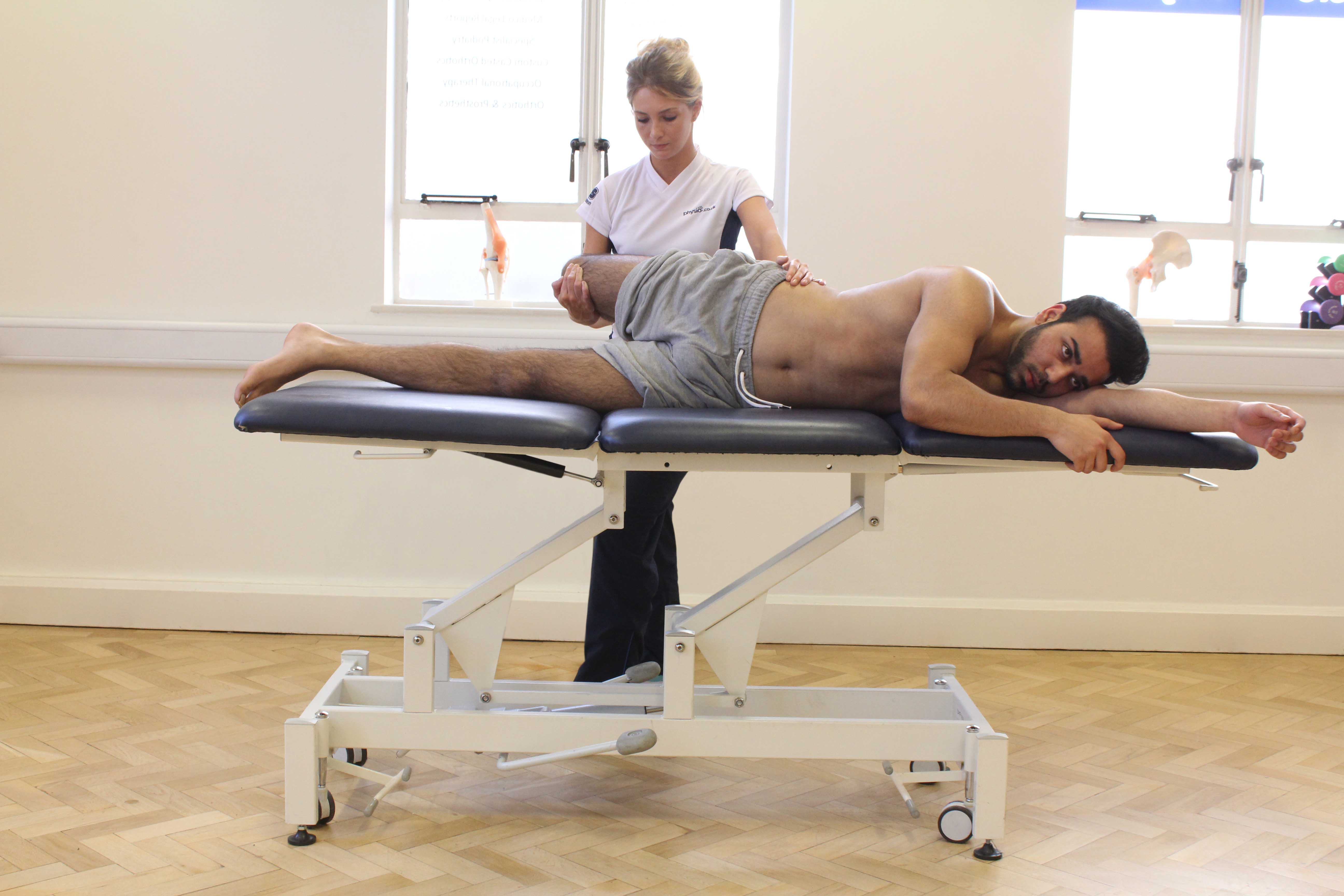 Passive stretch of the muscles and connective tissues of the hip by specialist therapist