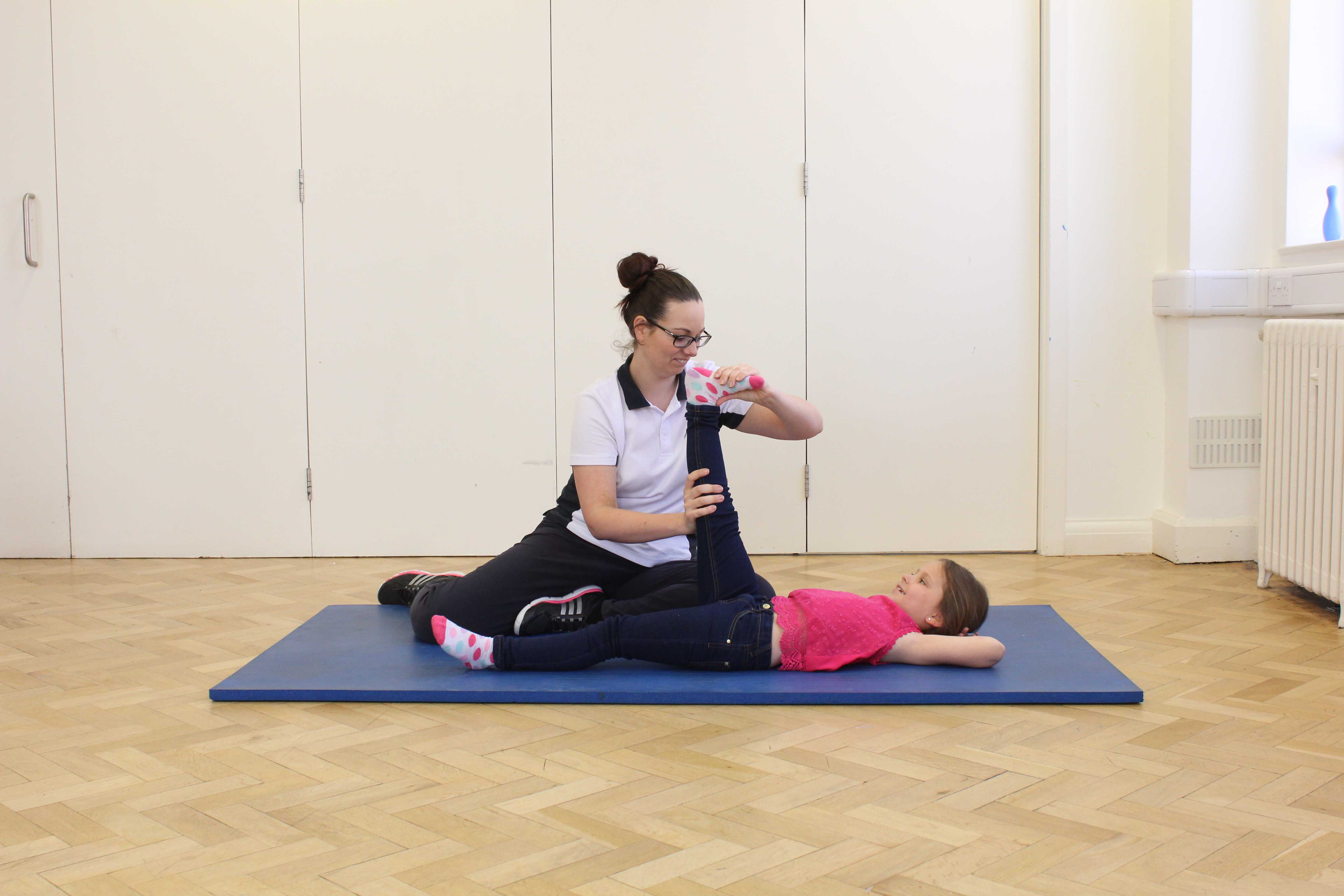 Passive stretches of the hip, knee and ankle to reduce contractures of the lower limb