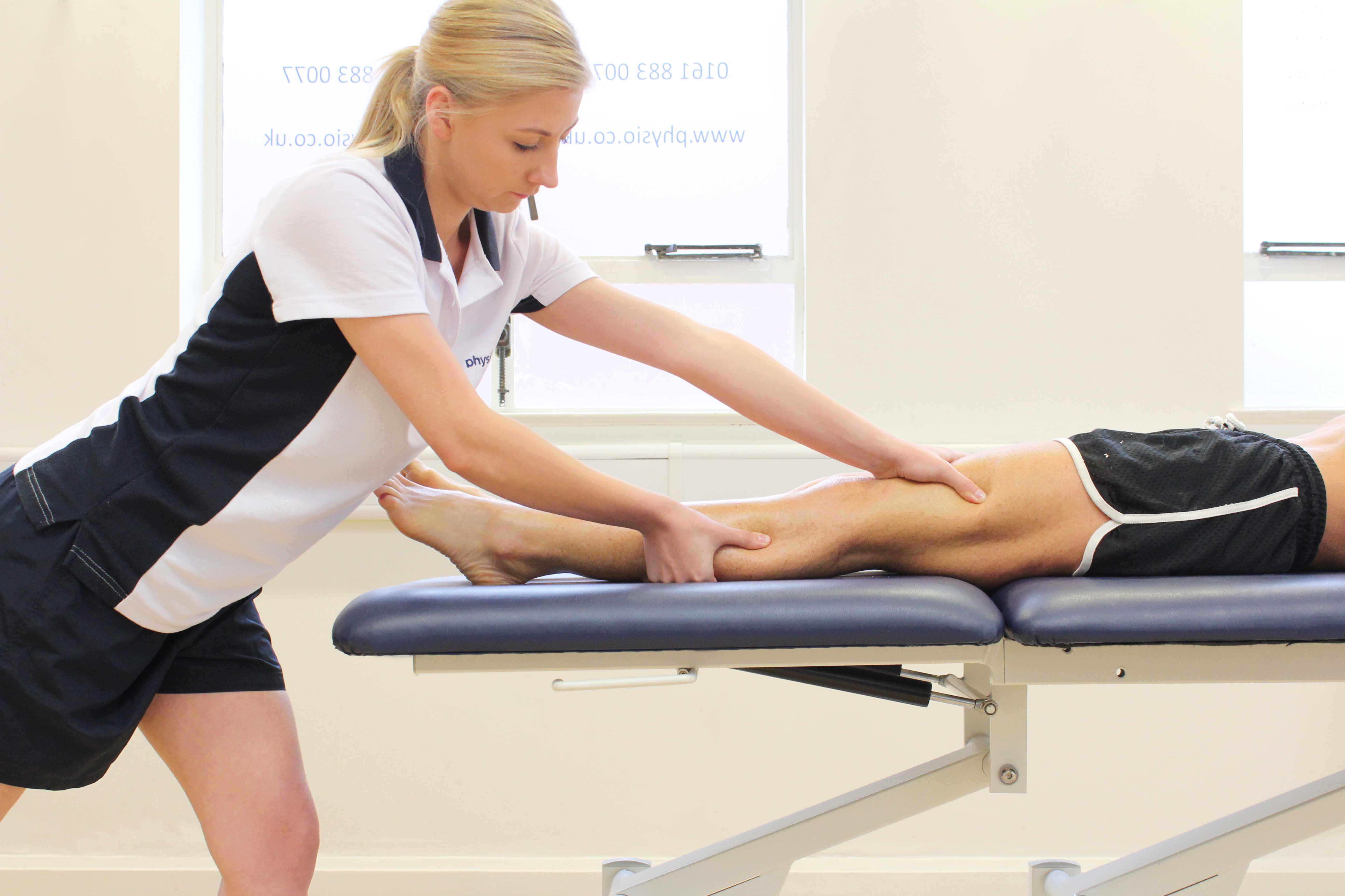 Deep tissue massage of the quadricep muscles by specialist therapist