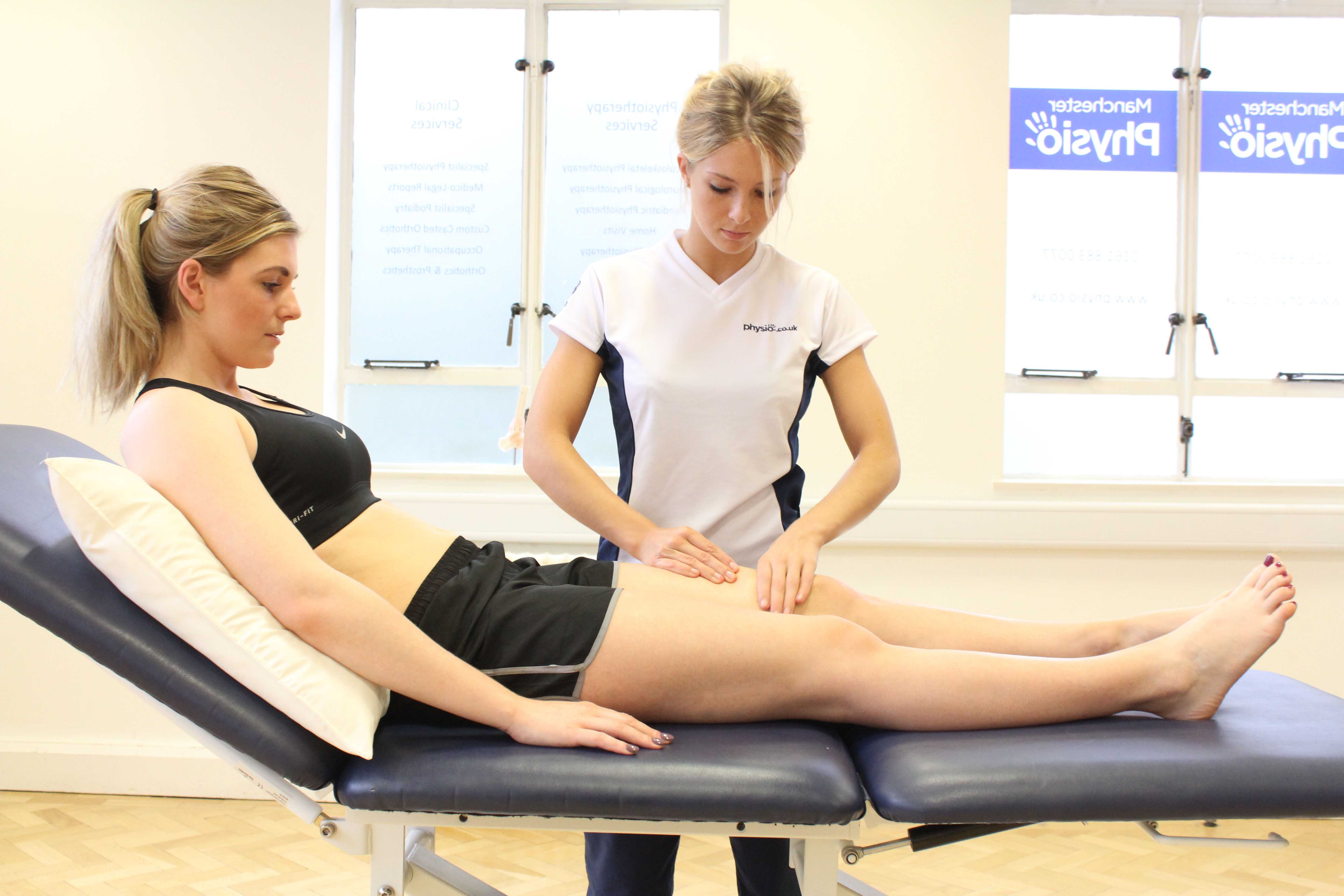 Deep tissue massage of the quadriceps to relieve muscle spasm