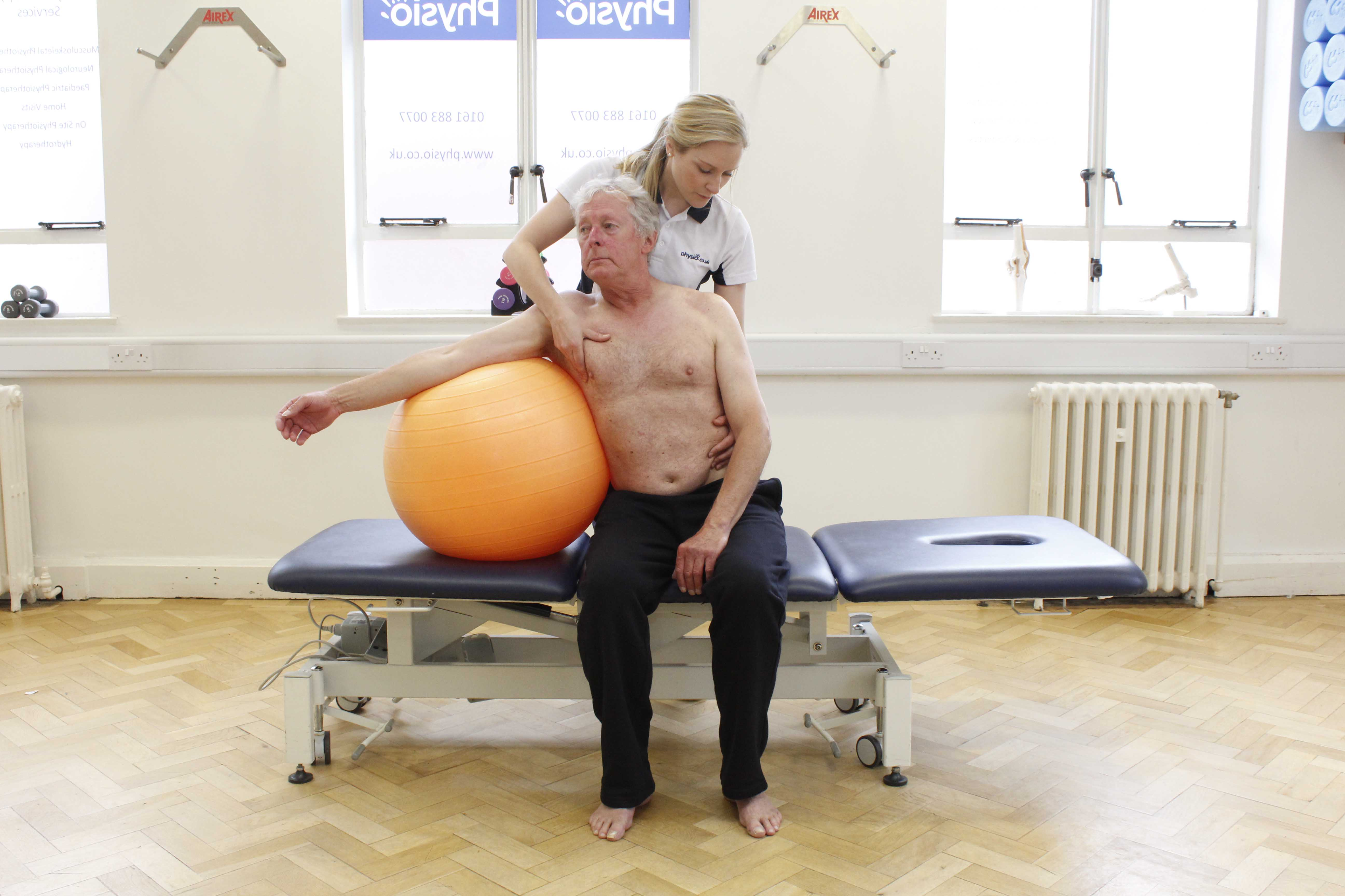 Mobilisation and stretch exercises for the spine assisted by an experienced physiotherapist