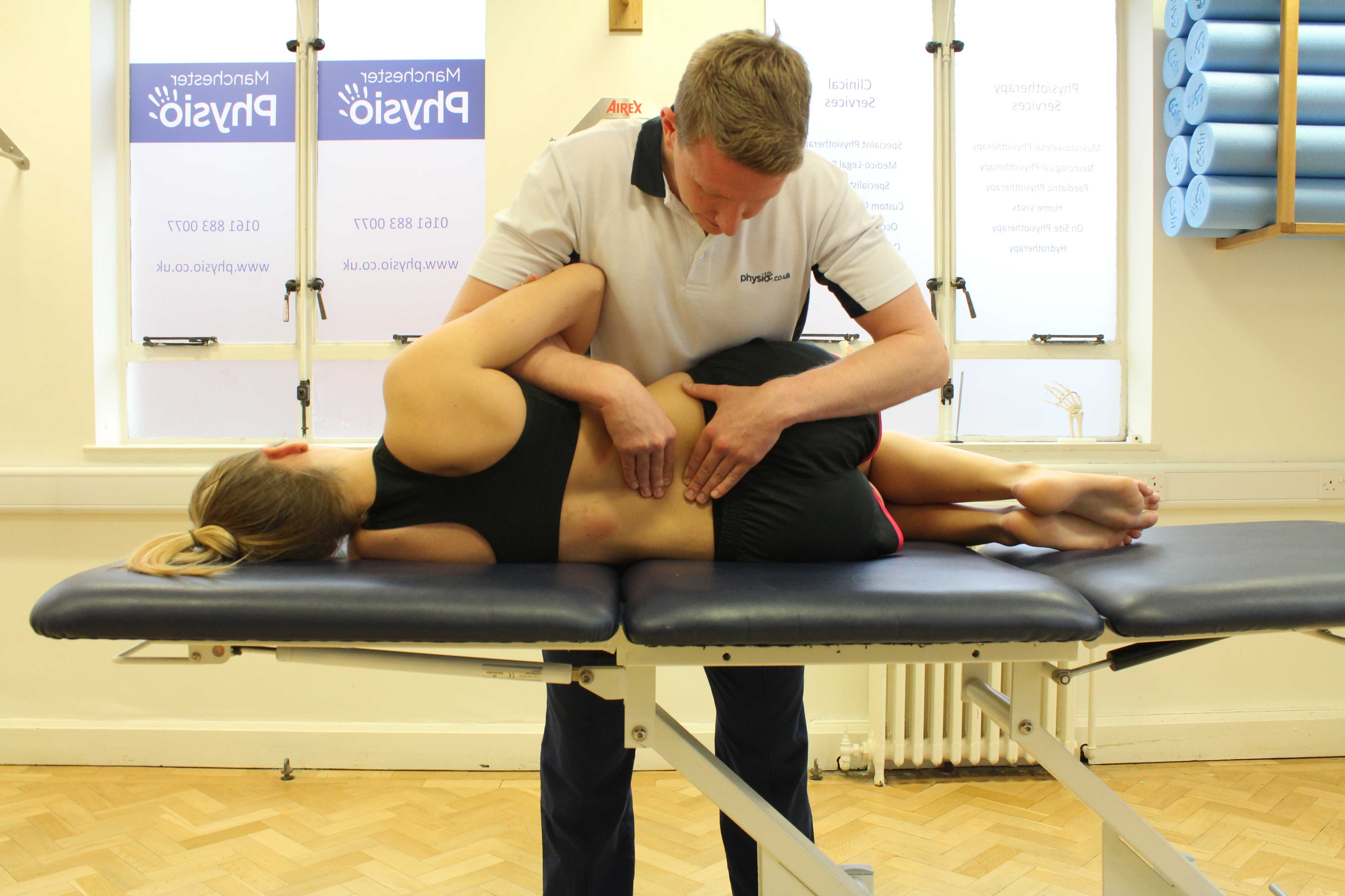 Mobilisations of the vertebrea in the lower back by experienced therapist