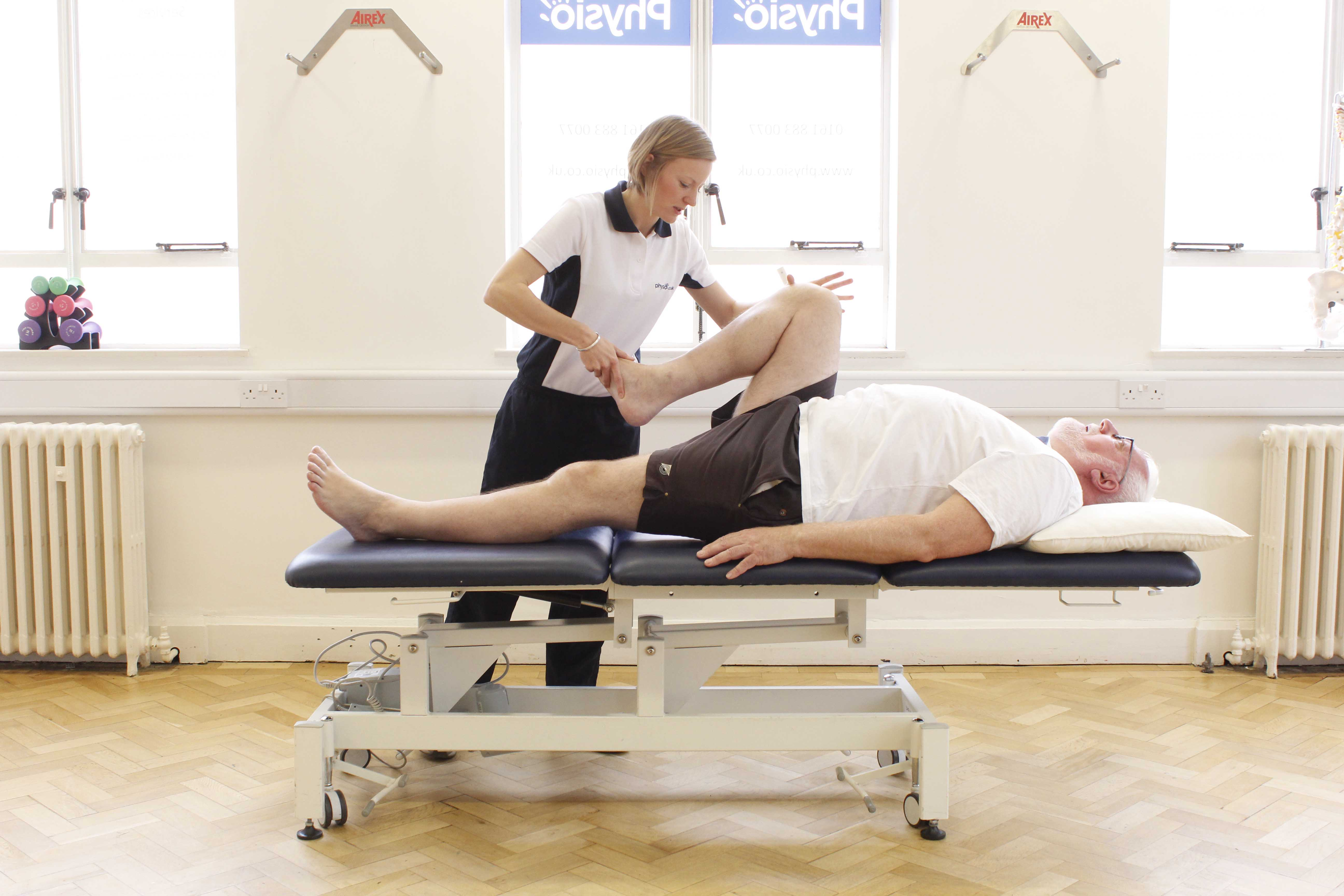 Stretches and mobilisation of the hip and knee joints by experienced musculoskeletal physiotherapist