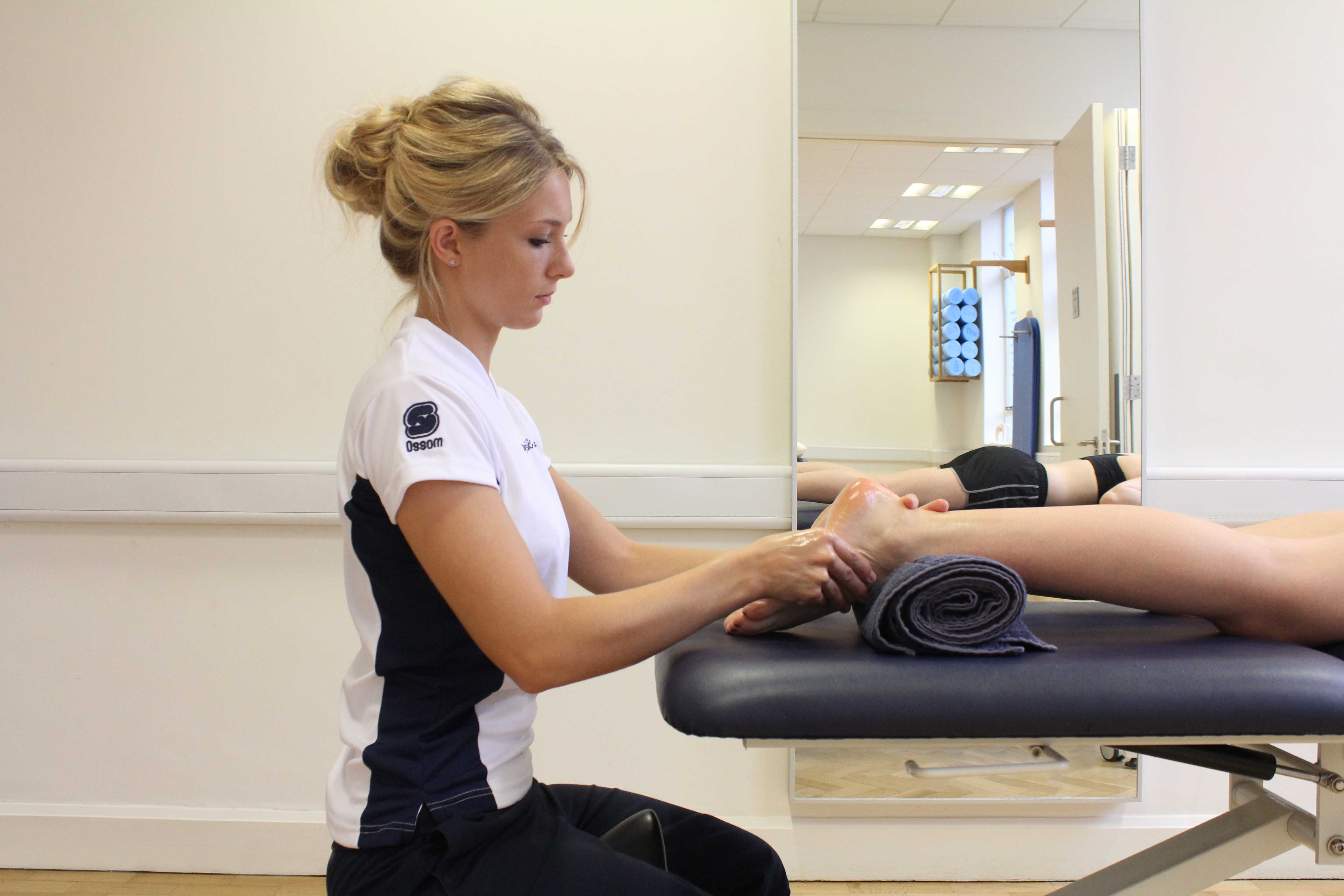 Soft tissue massage and mobilisations of the bones and connective tissues in the foot by an experienced therapist