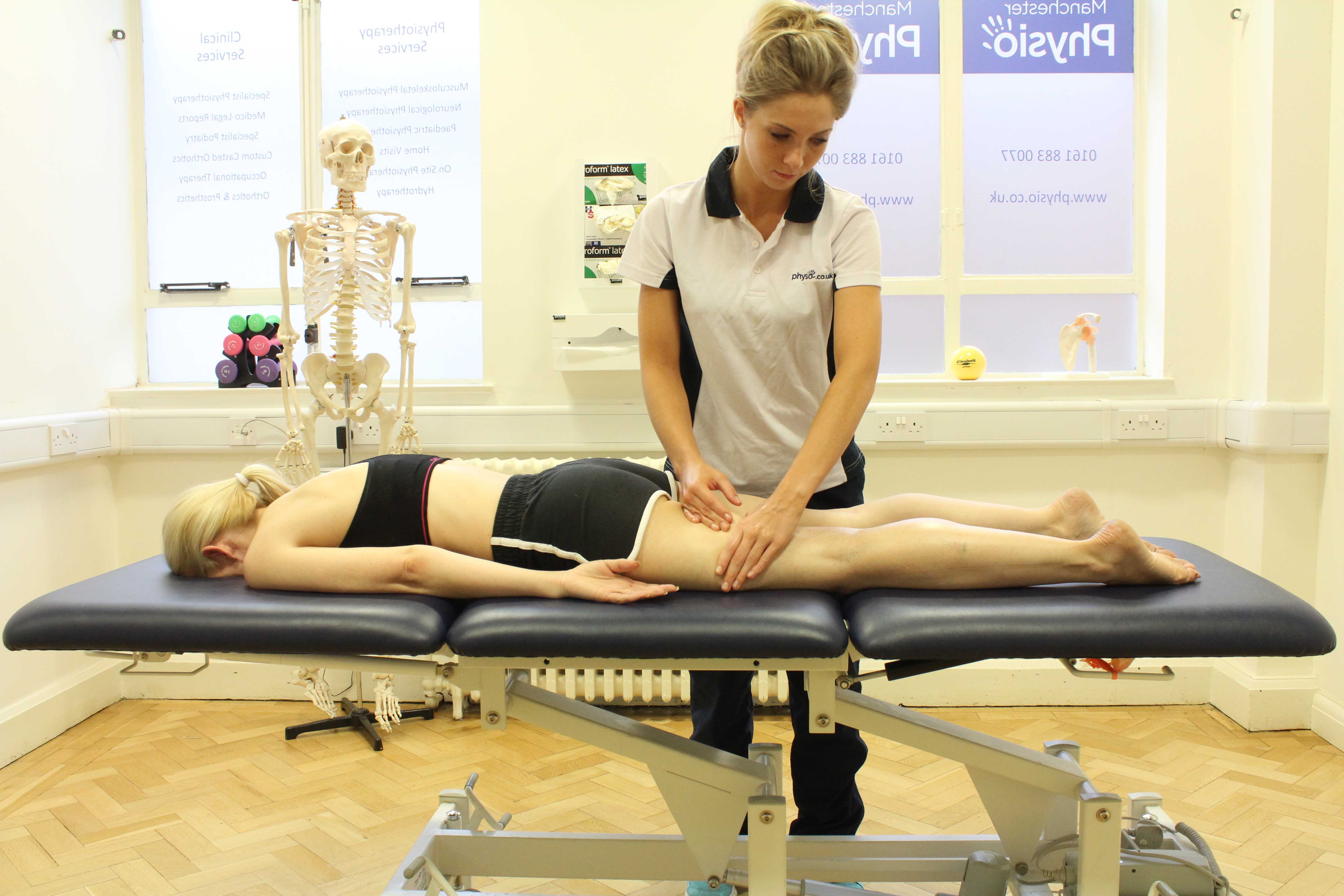 Rolling soft tissue massage of the hamstring muscles by specialist therapist