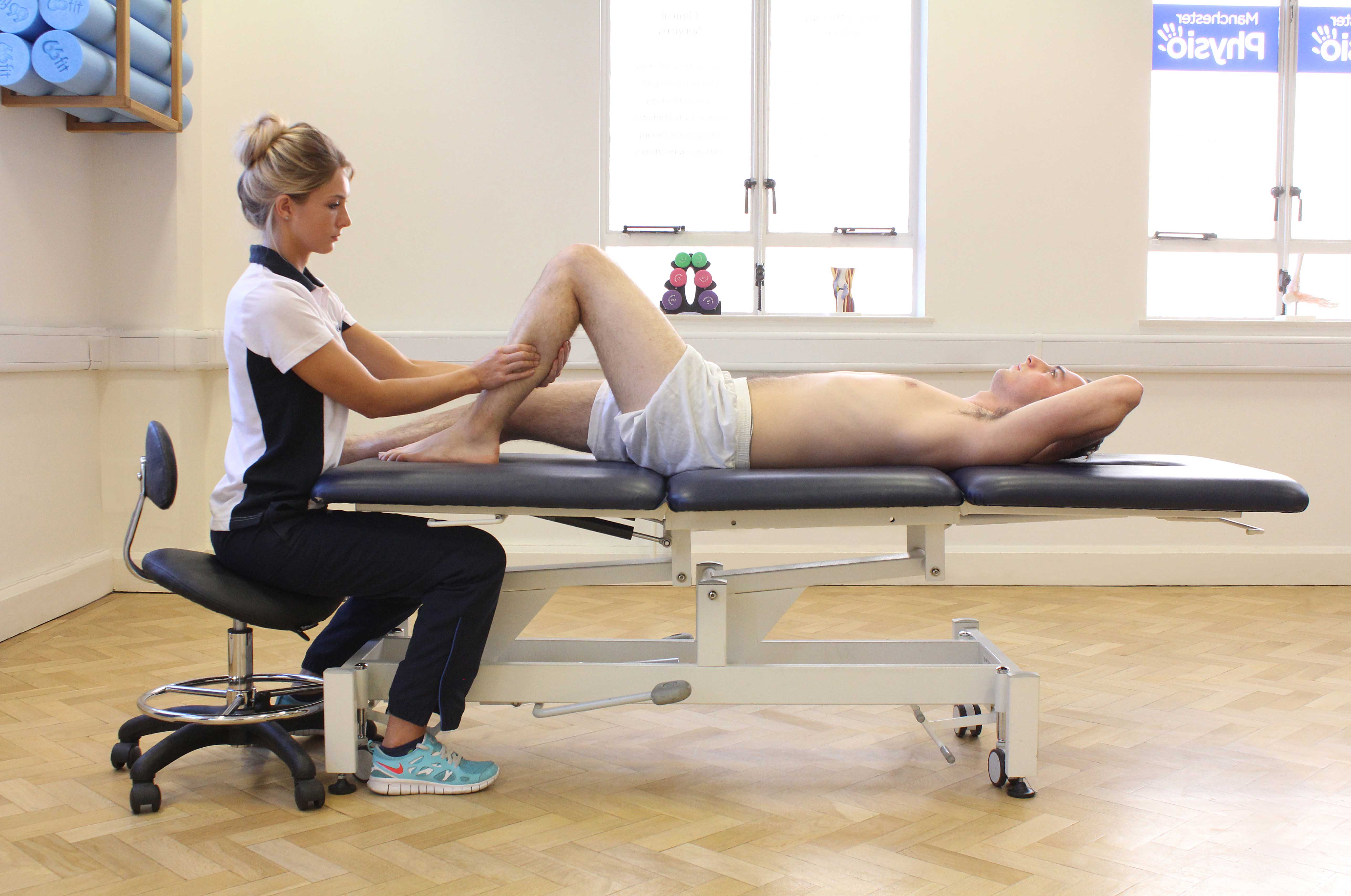 Soft tissue massage applied to soleus muscle by specilaist therapist