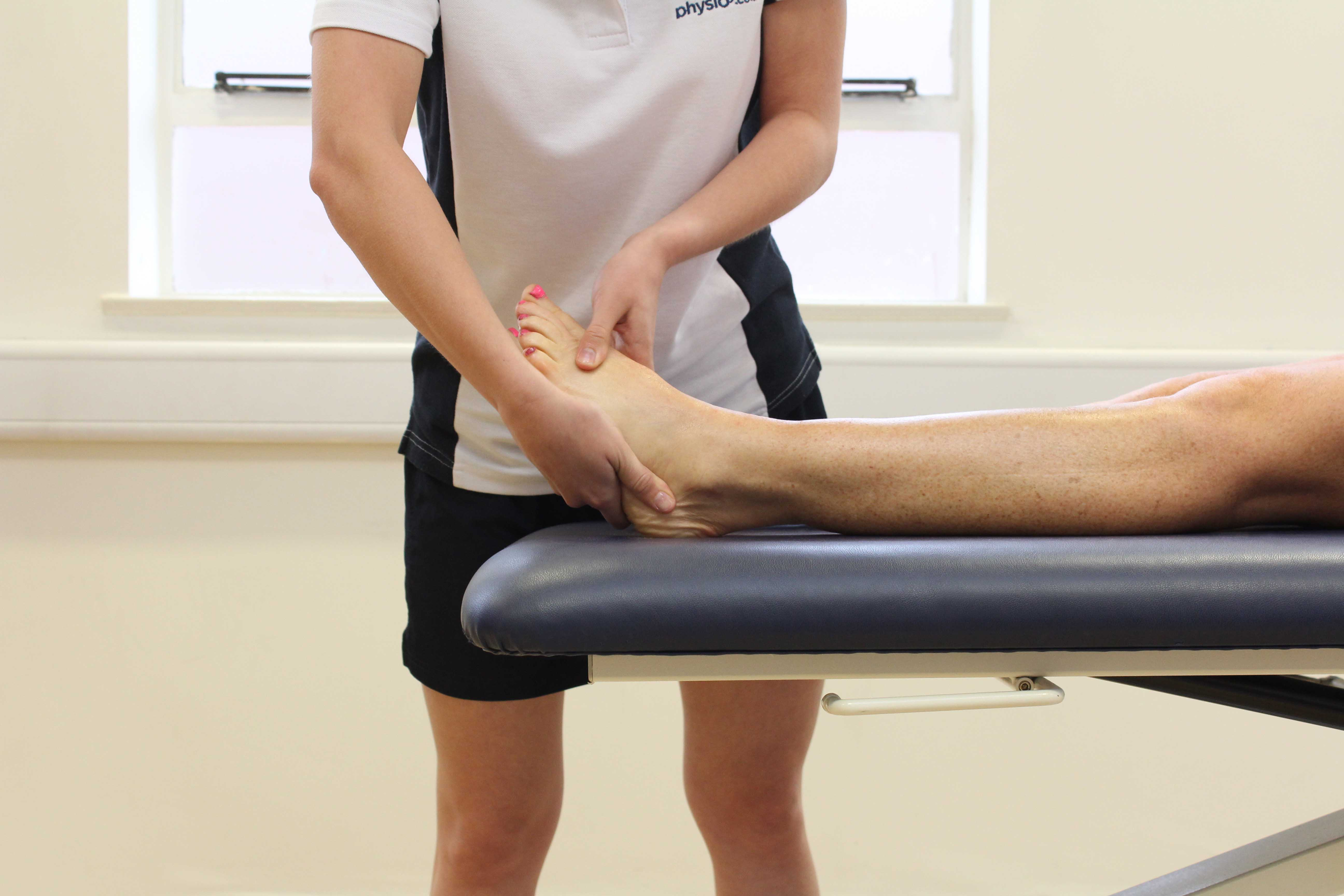 Soft tissue massage applied to the bones and connective tissue on the anterior portion of the foot