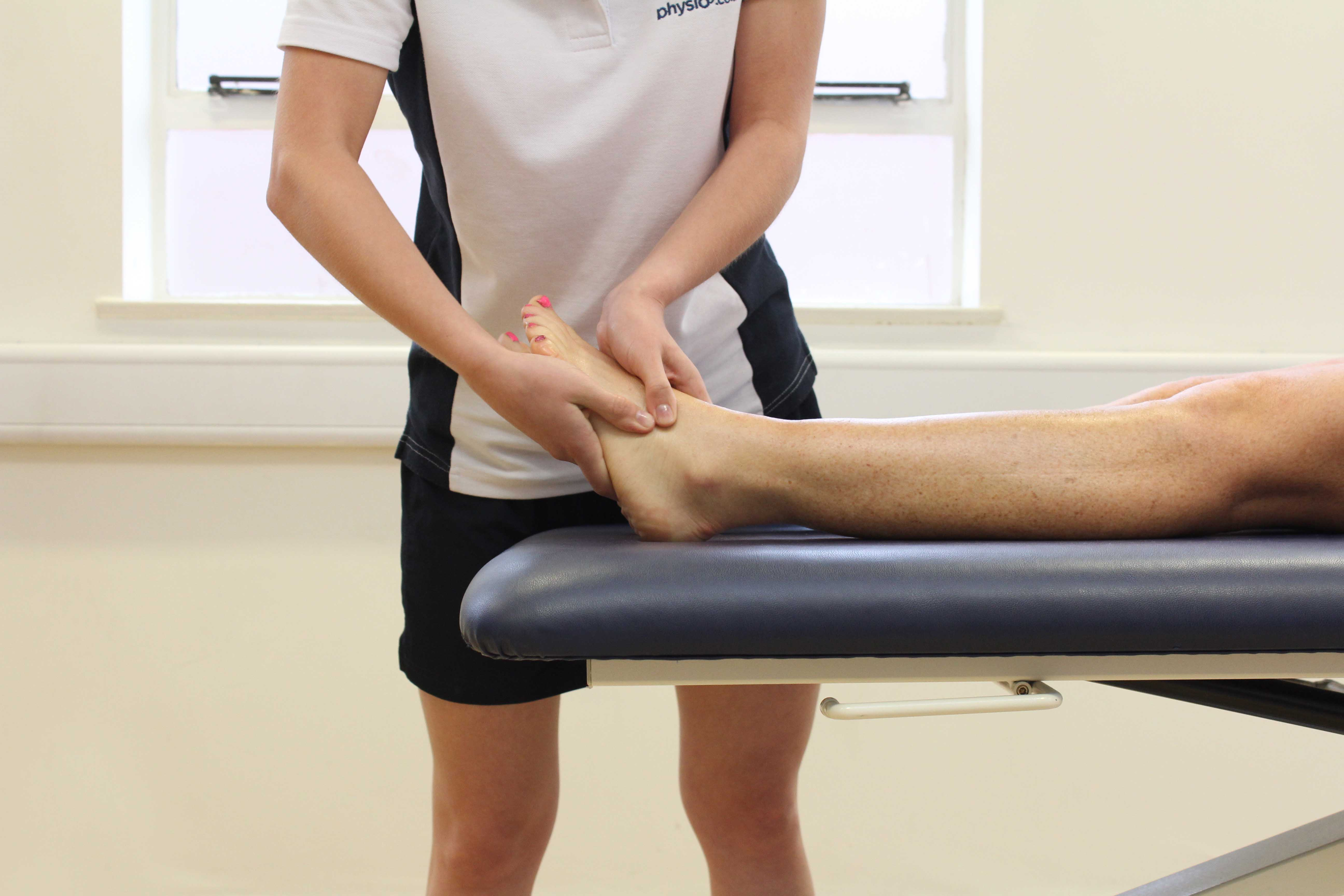 Friction massage applied to the foot by specialist therapist