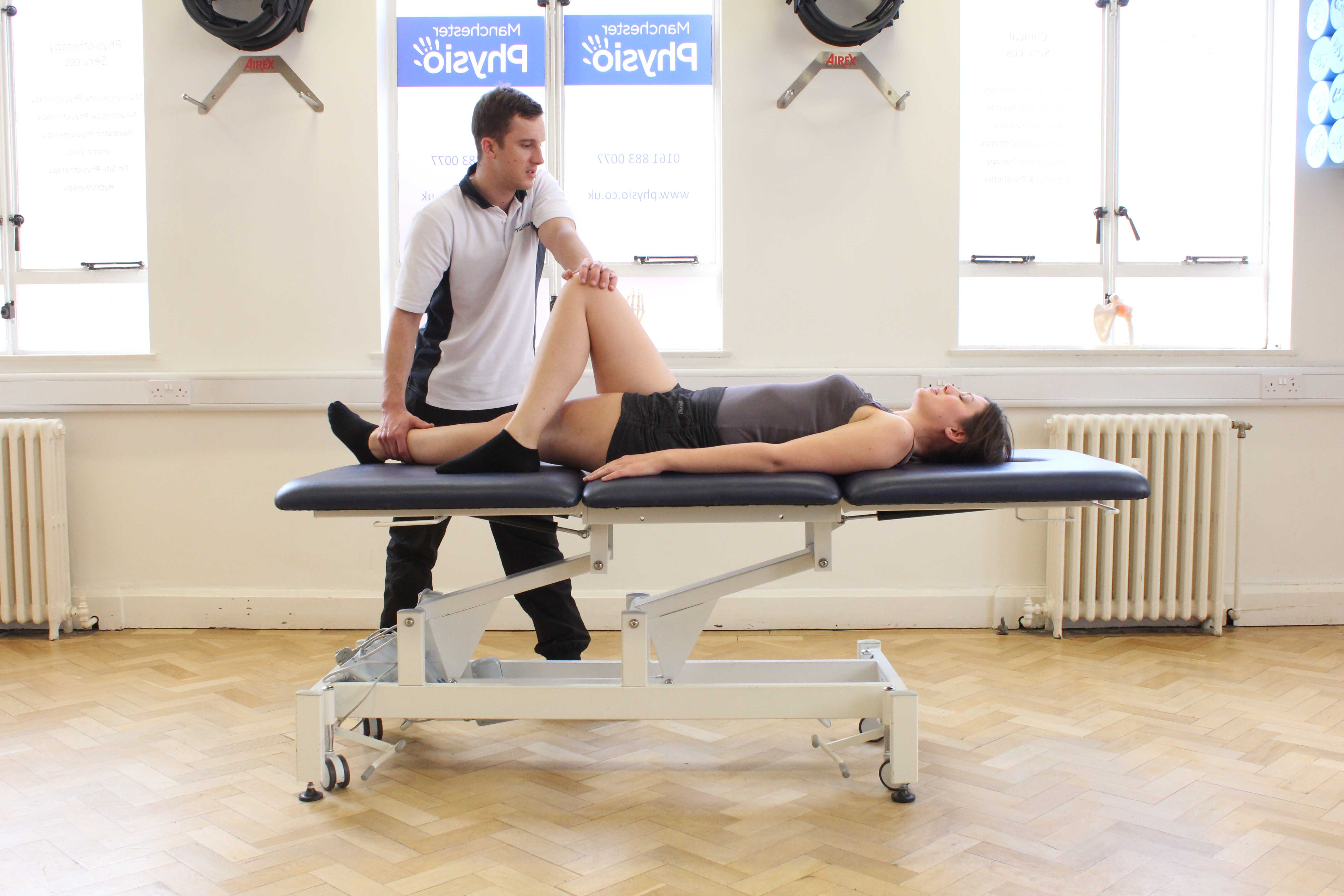 Passive stretch of the muscles and connective tissues of the hip and pelvis by specialist therapist