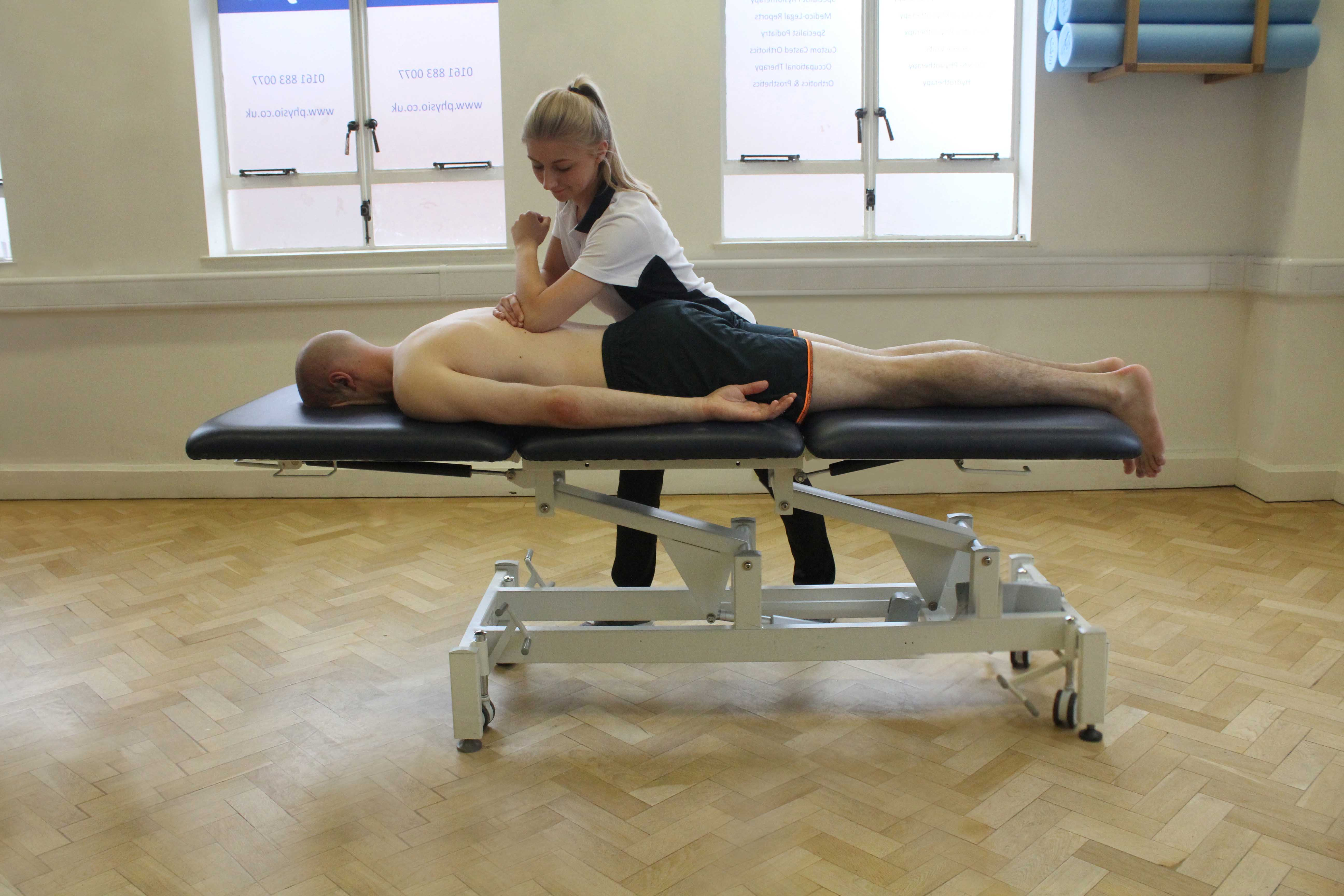 Soft Tissue Massage targeting latissimus dorsi muscle