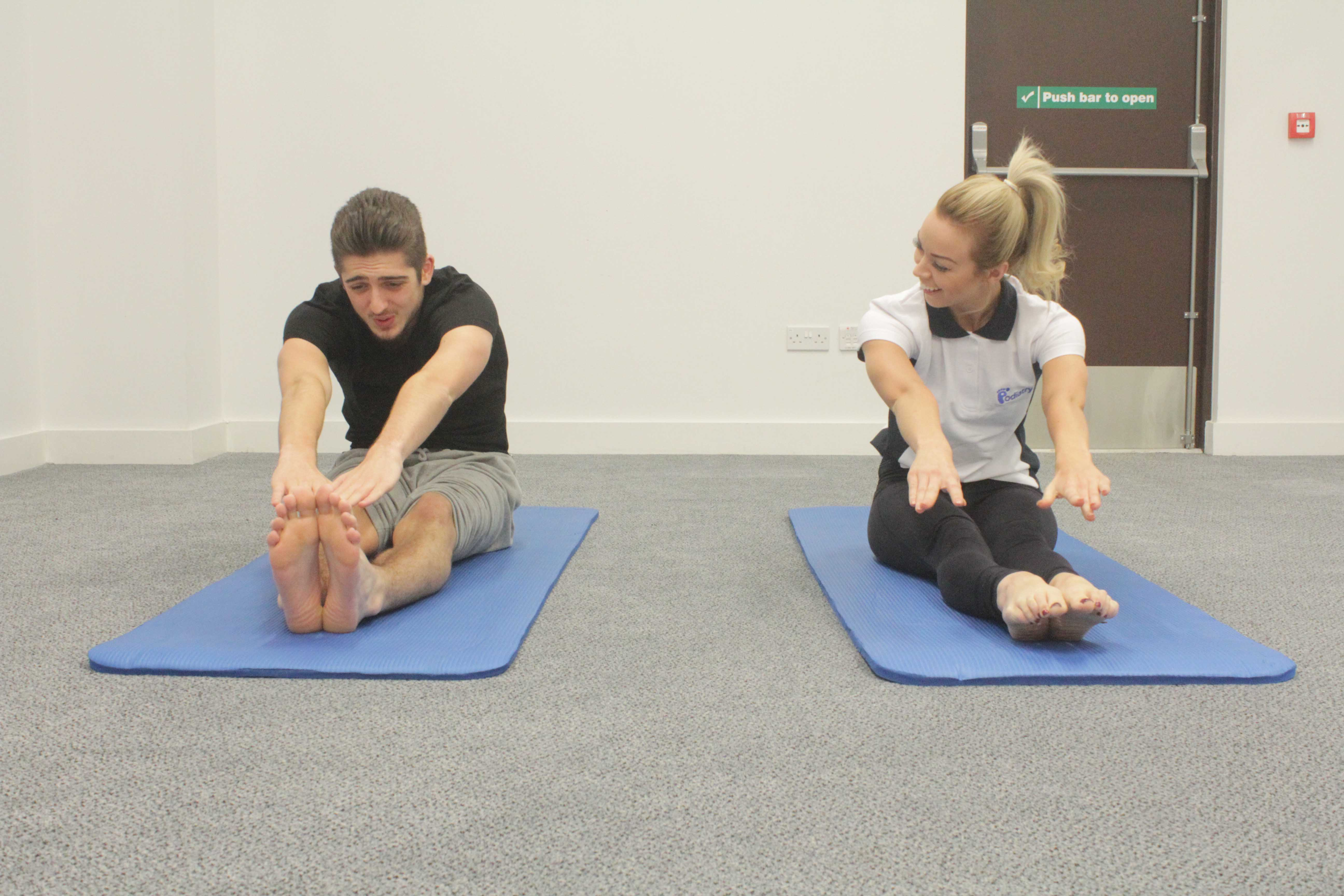 Stetch exercises using a resistance band, guided by a specialist paediatric physiotherapist