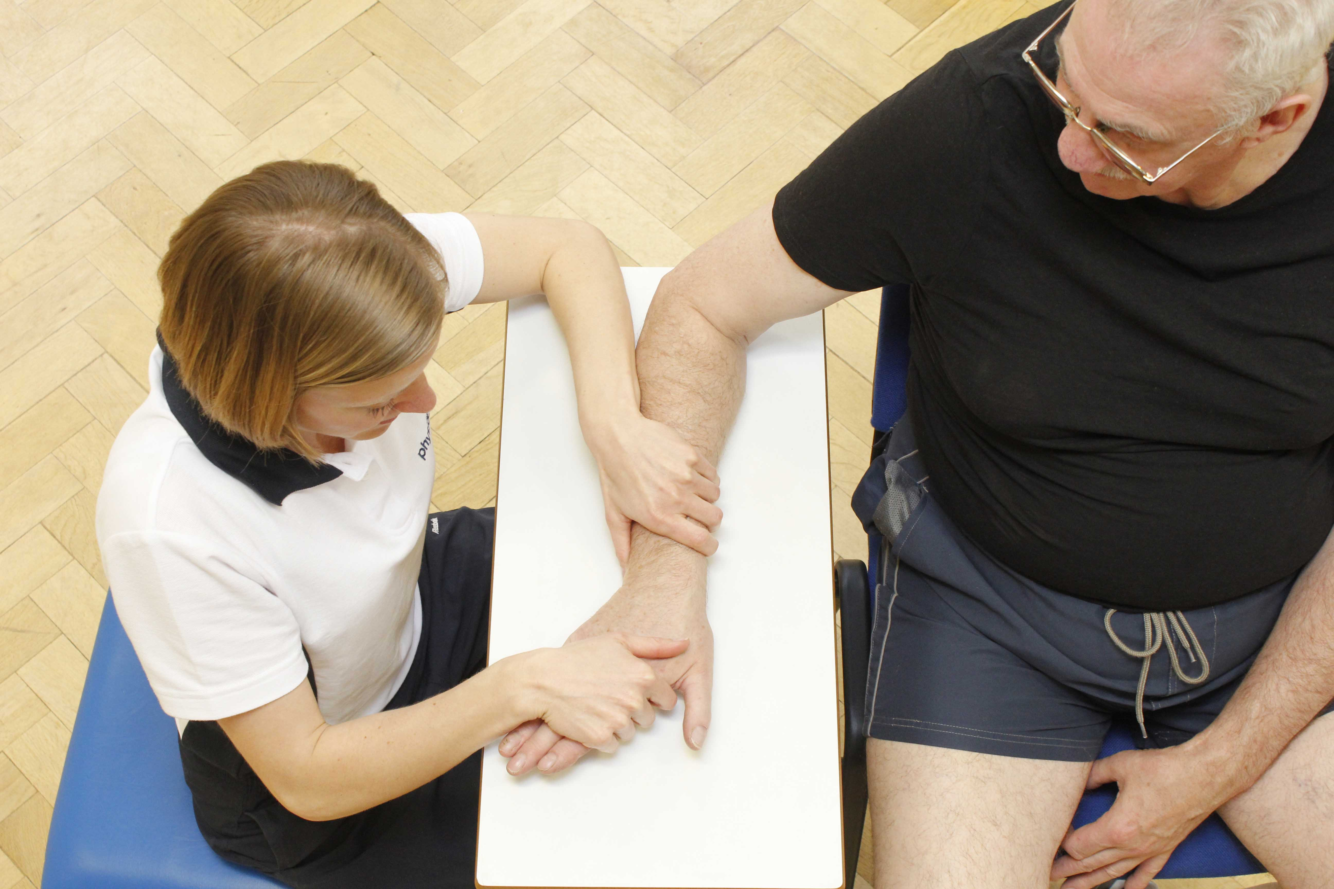 Hand and wrist stretches and mobilisations by experienced MSK physiotherapist