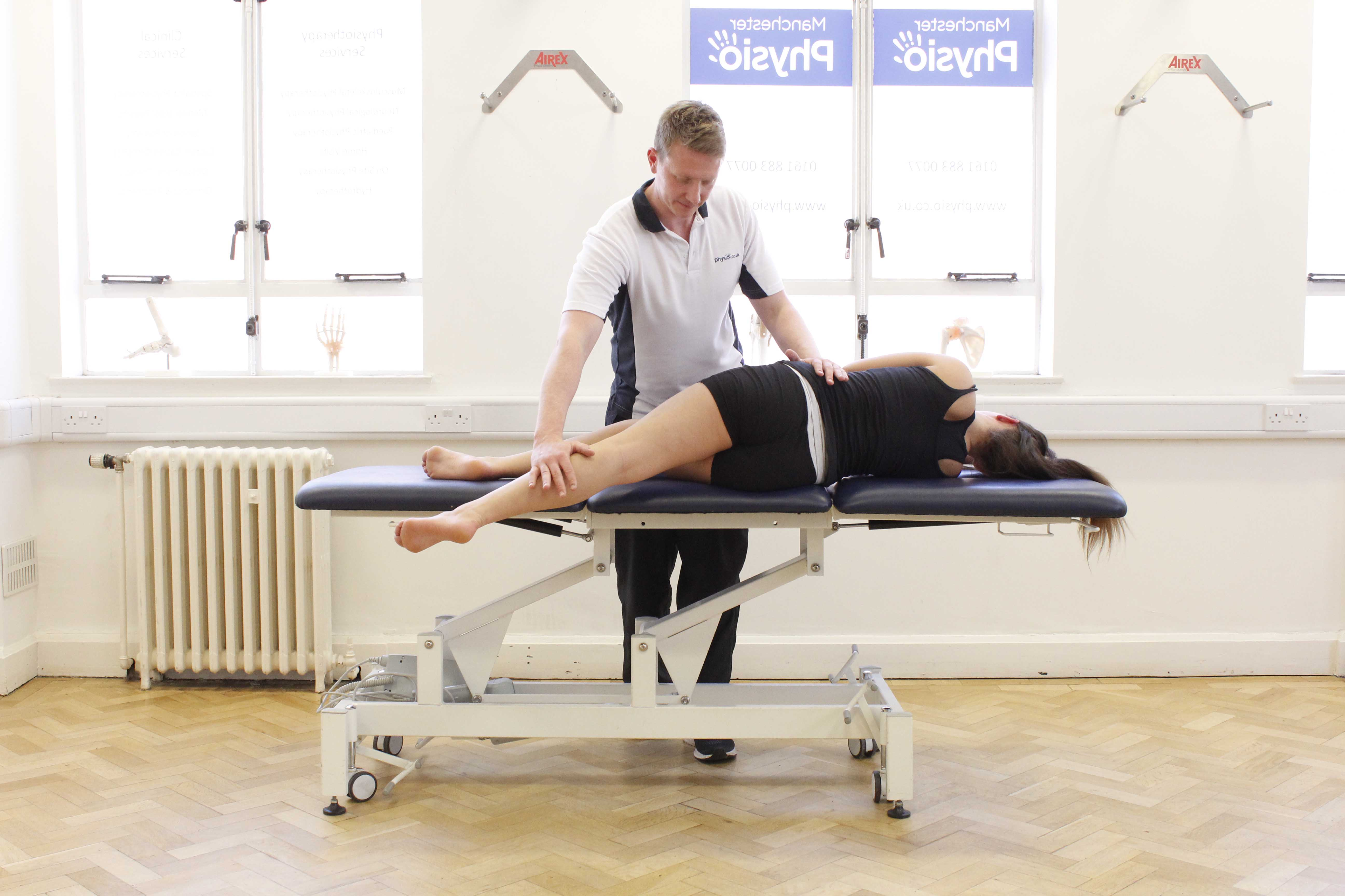 Mobility exercises and stretches of the hip and pelvis performed by an experienced physiotherapist