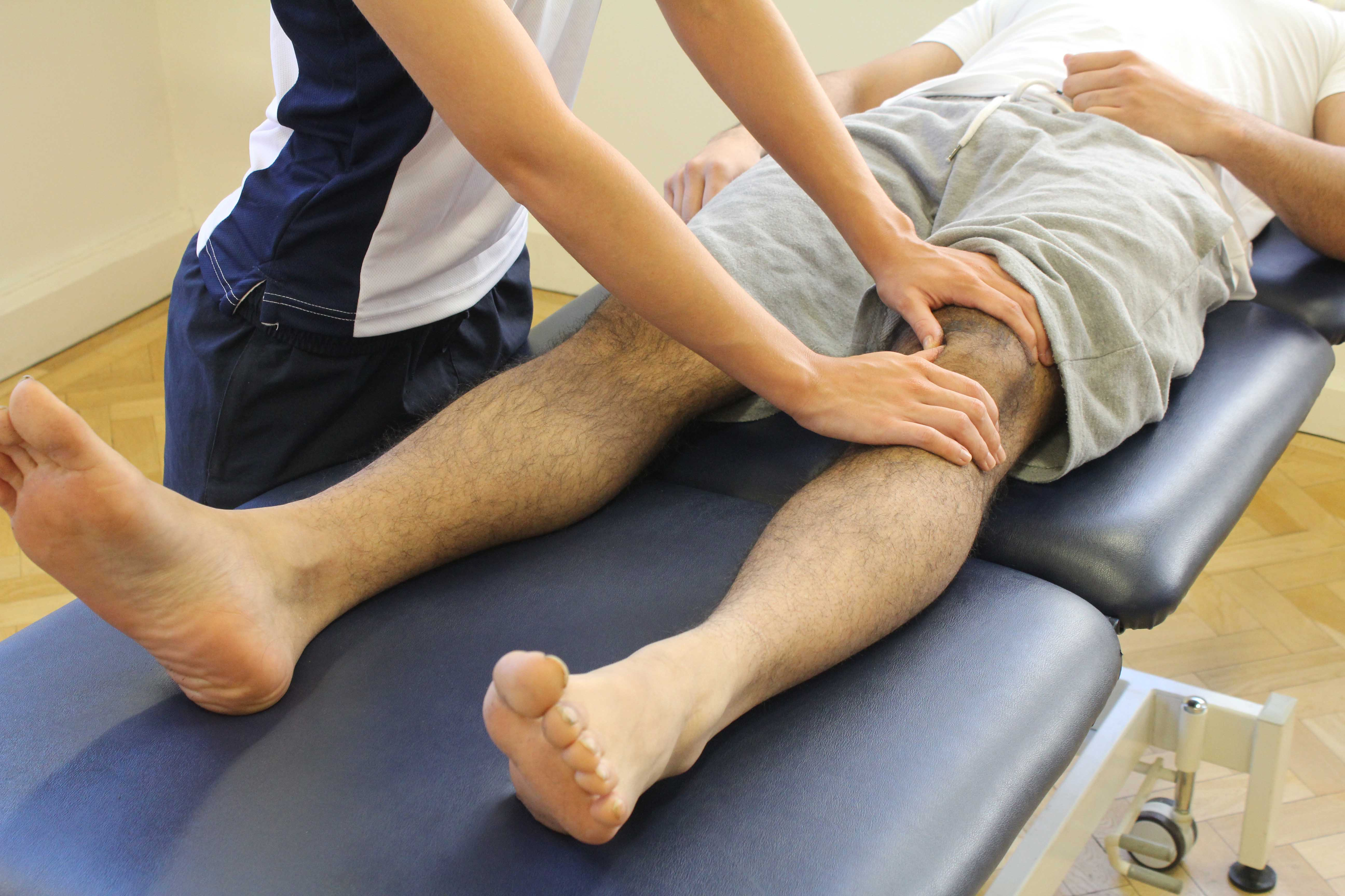Soft tissue massage and mobilisations of the patella to disperse swelling from the knee joint
