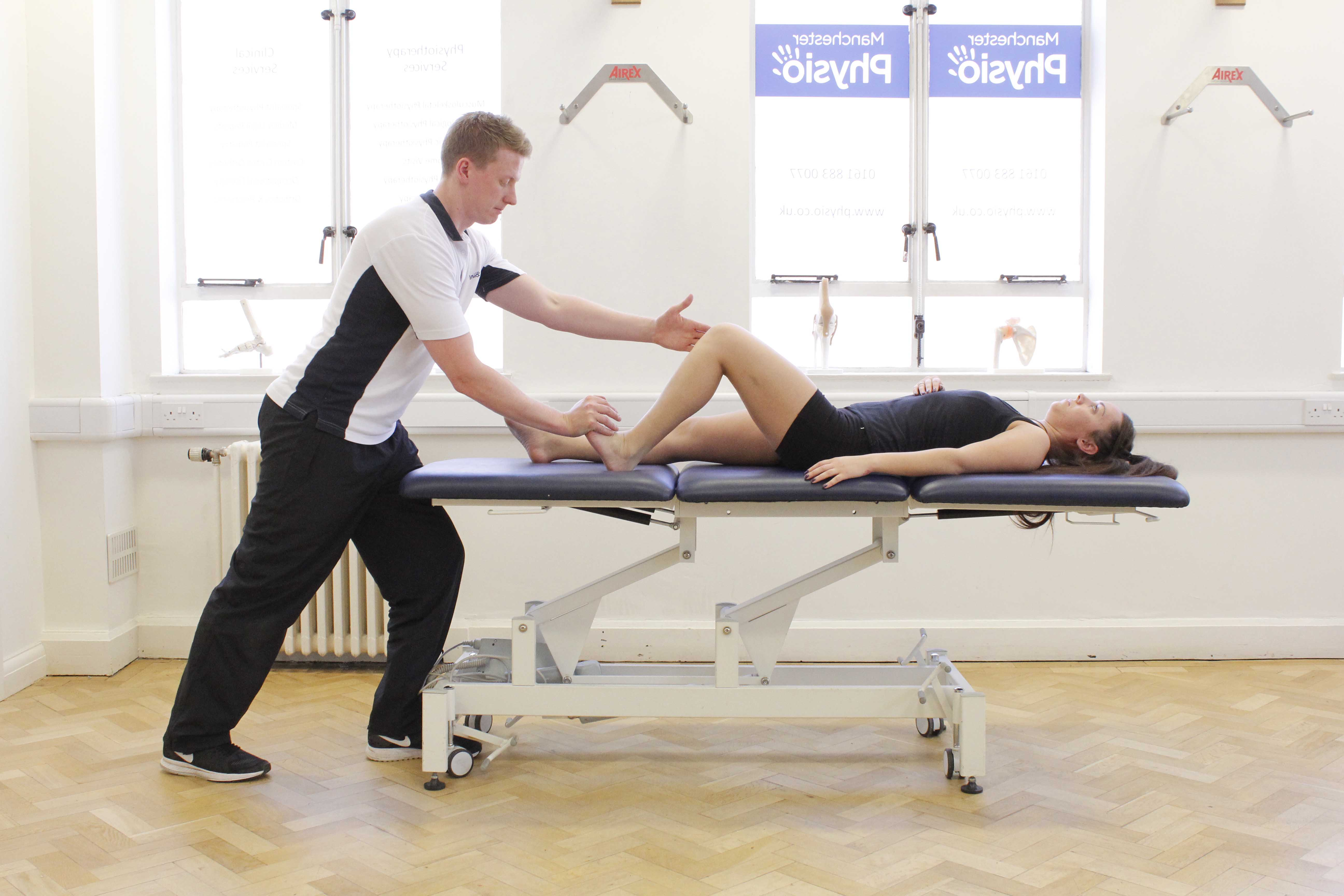 Foot and ankle mobilisations and stretches performed by a physiotherapist