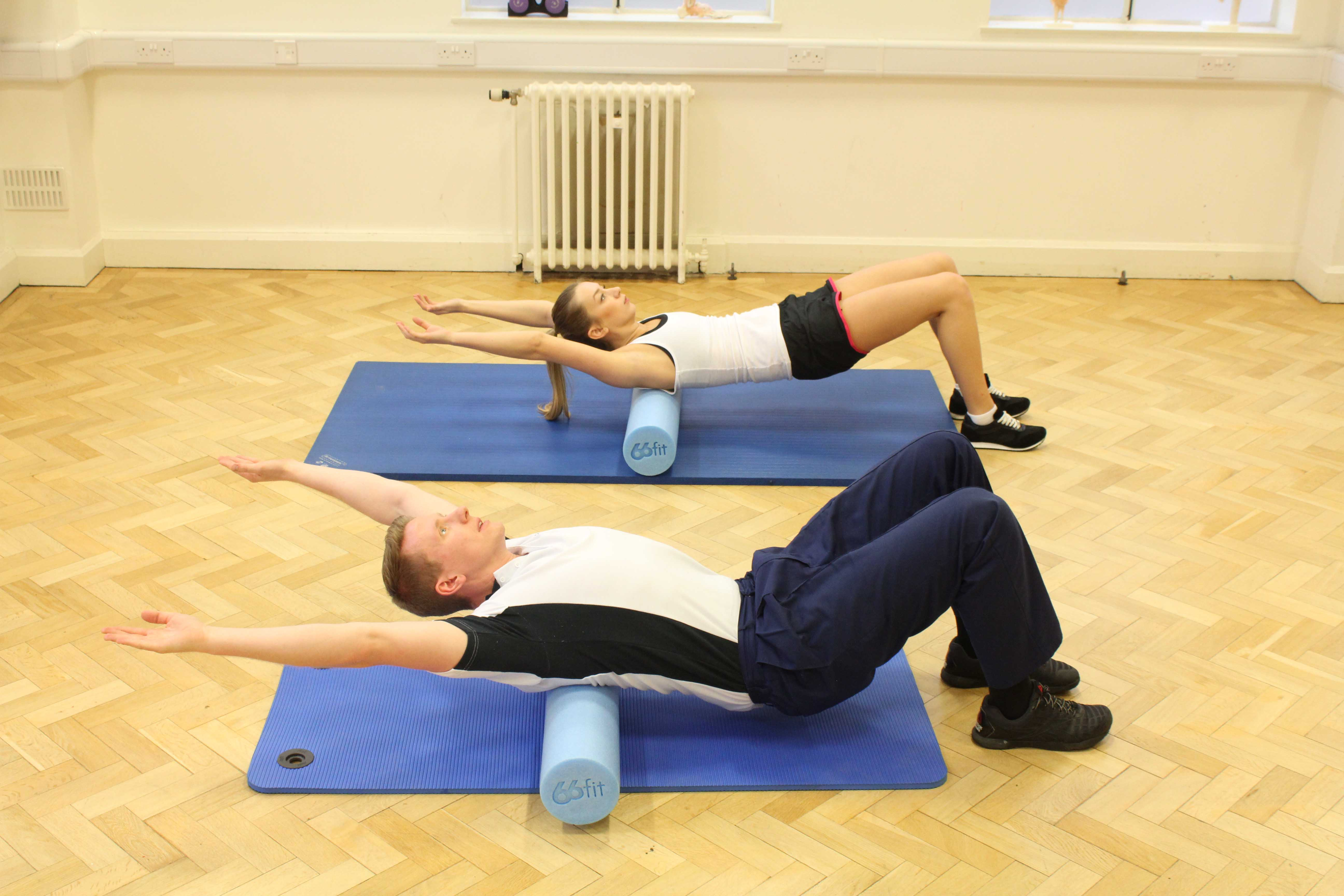 Passive stretches and mobilisations of the upper back using a therapy aid.