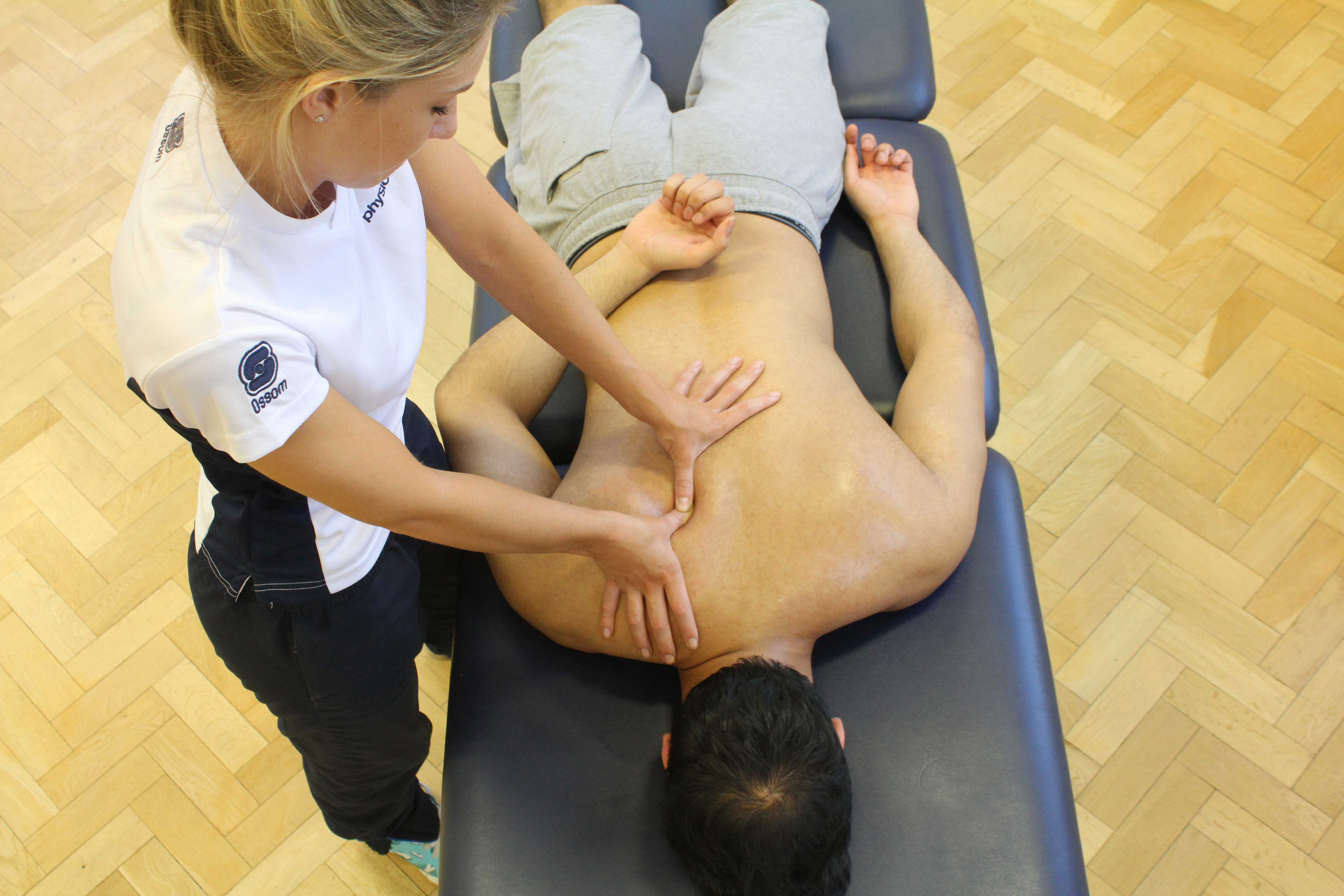 Trigger point massage of the muscles in the upper back