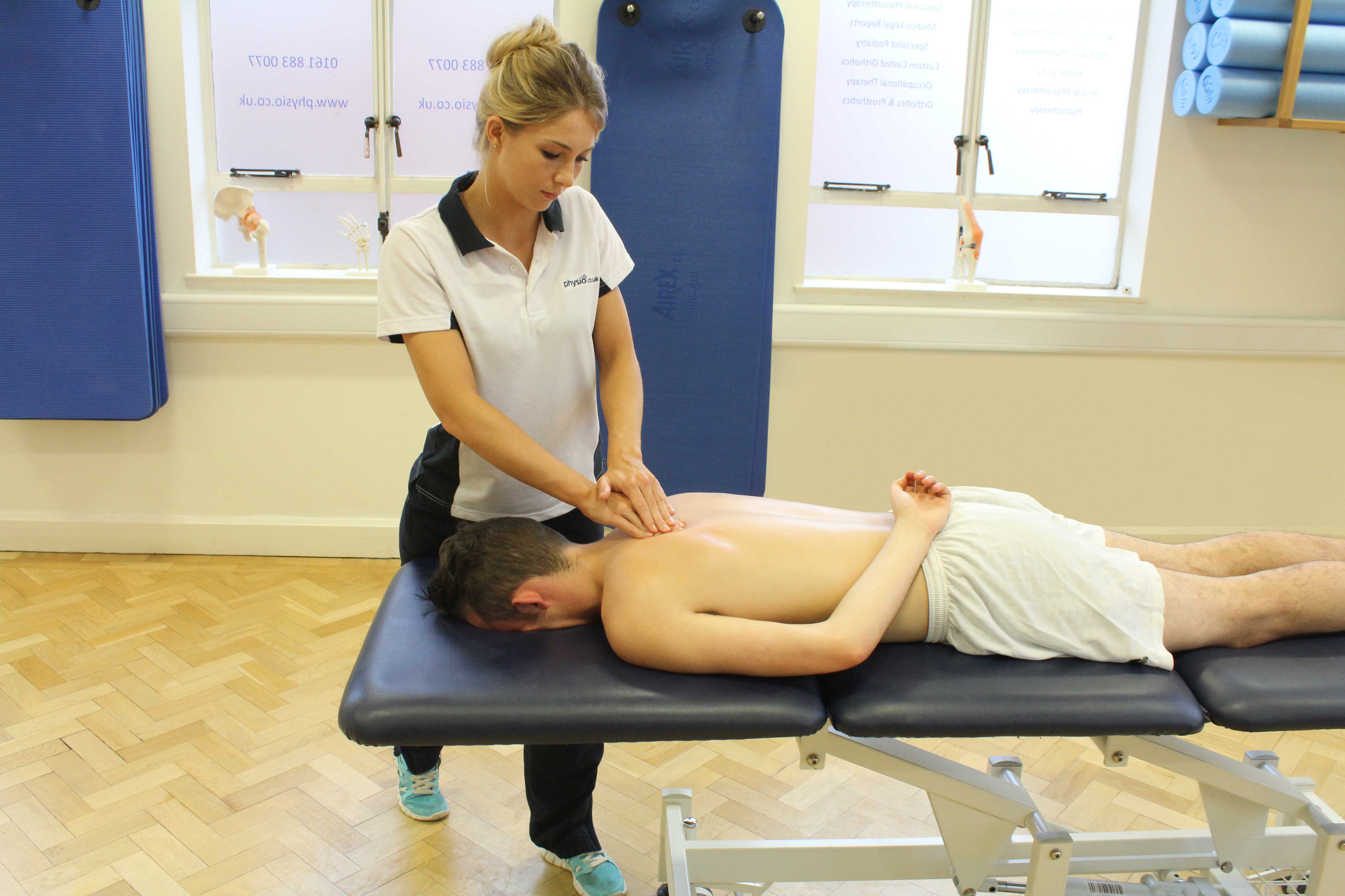 Soft tissue massage of the upper back muscles